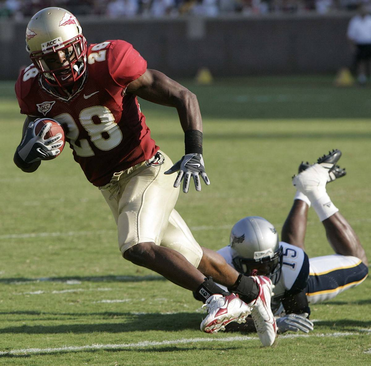 Florida State runningback Lorenzo Booker, left, runs away from Rice's Brandon King for a third-quarter touchdown, Saturday, Sept. 23, 2006, in Tallahassee, Fla.(AP Photo/Phil Coale)