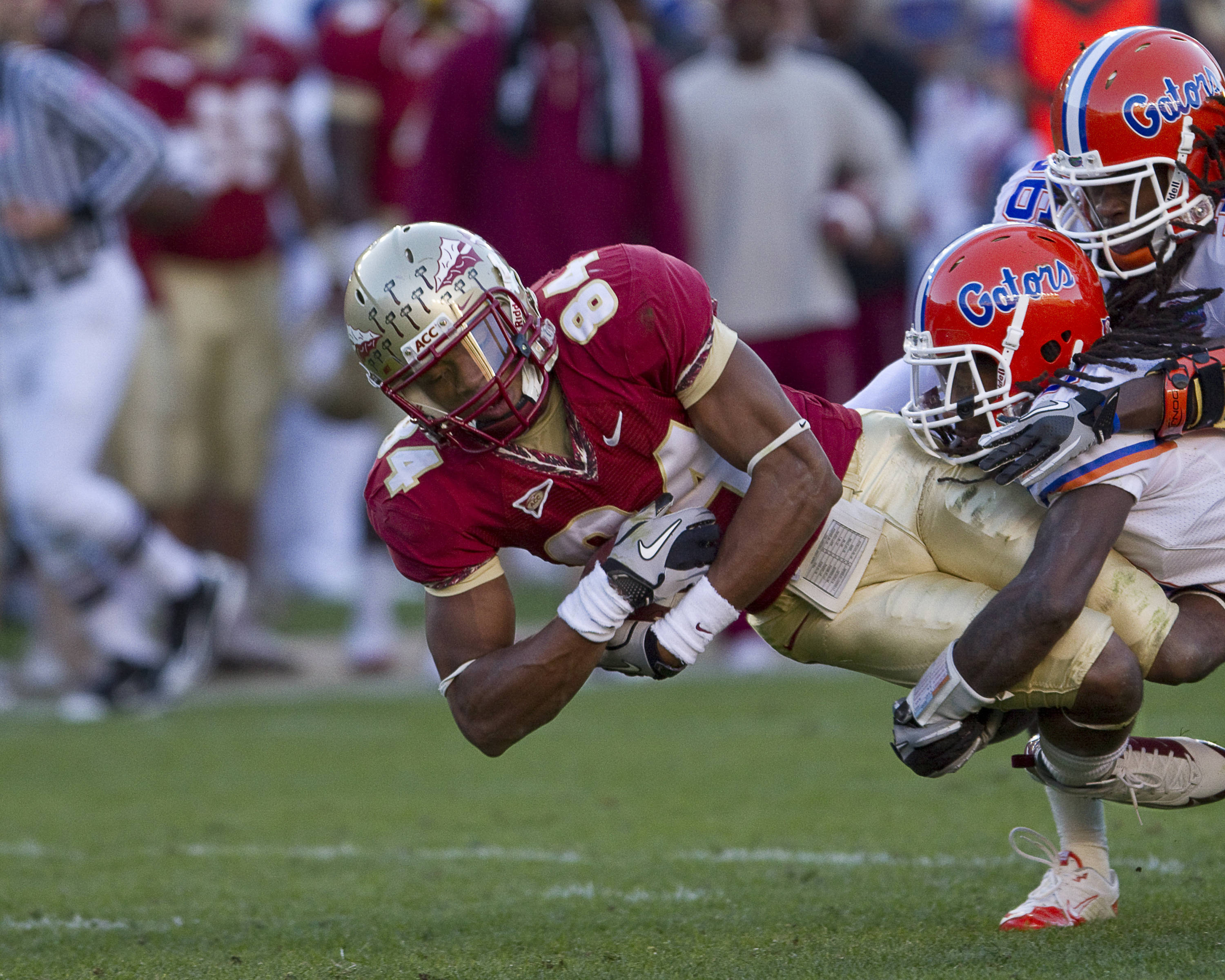 Rodney Smith (84) is tackled as he dives forward.