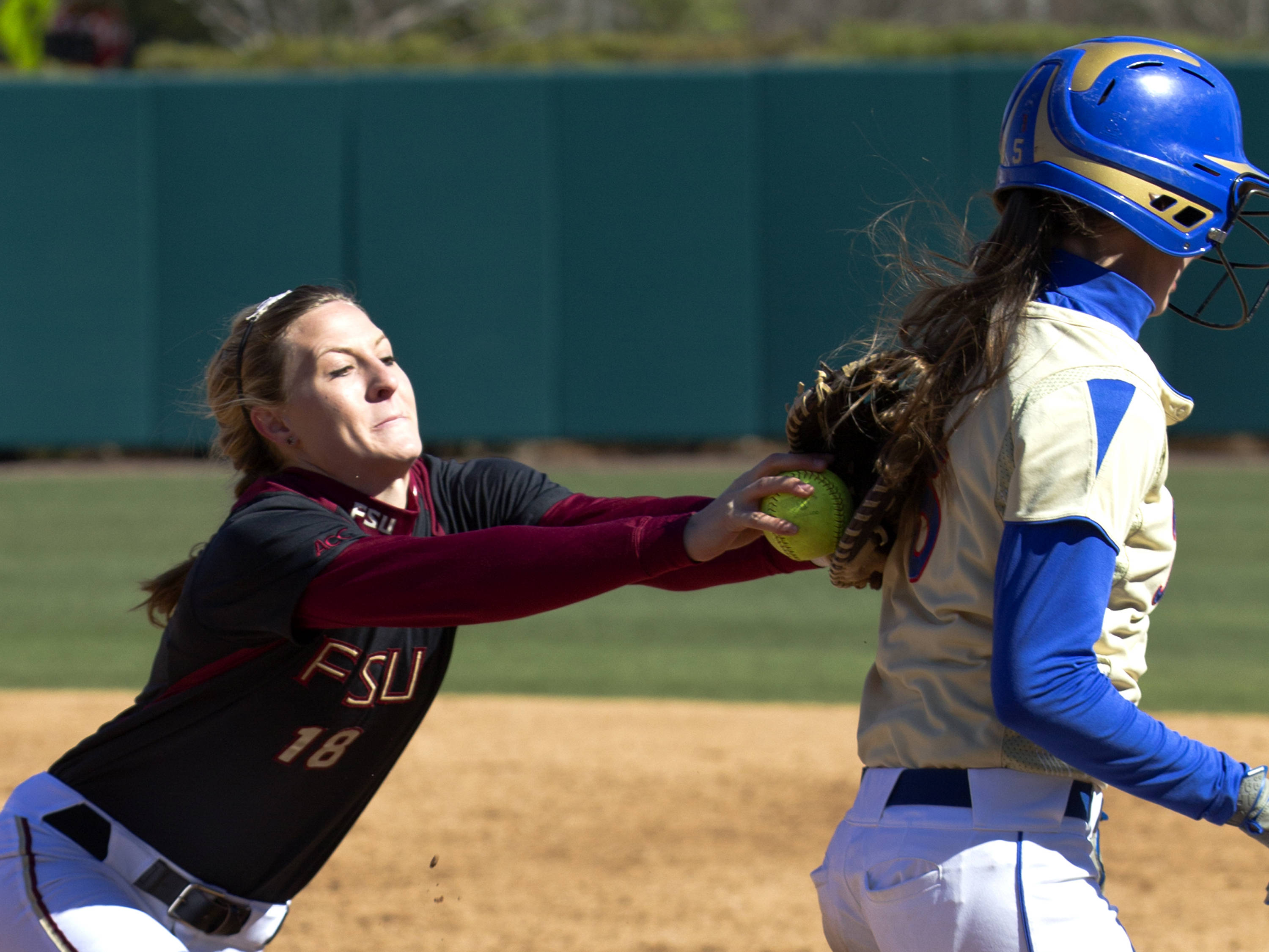 Victoria West (18), with a tag at first base, FSU vs Tulsa, 02/17/13. (Photo by Steve Musco)