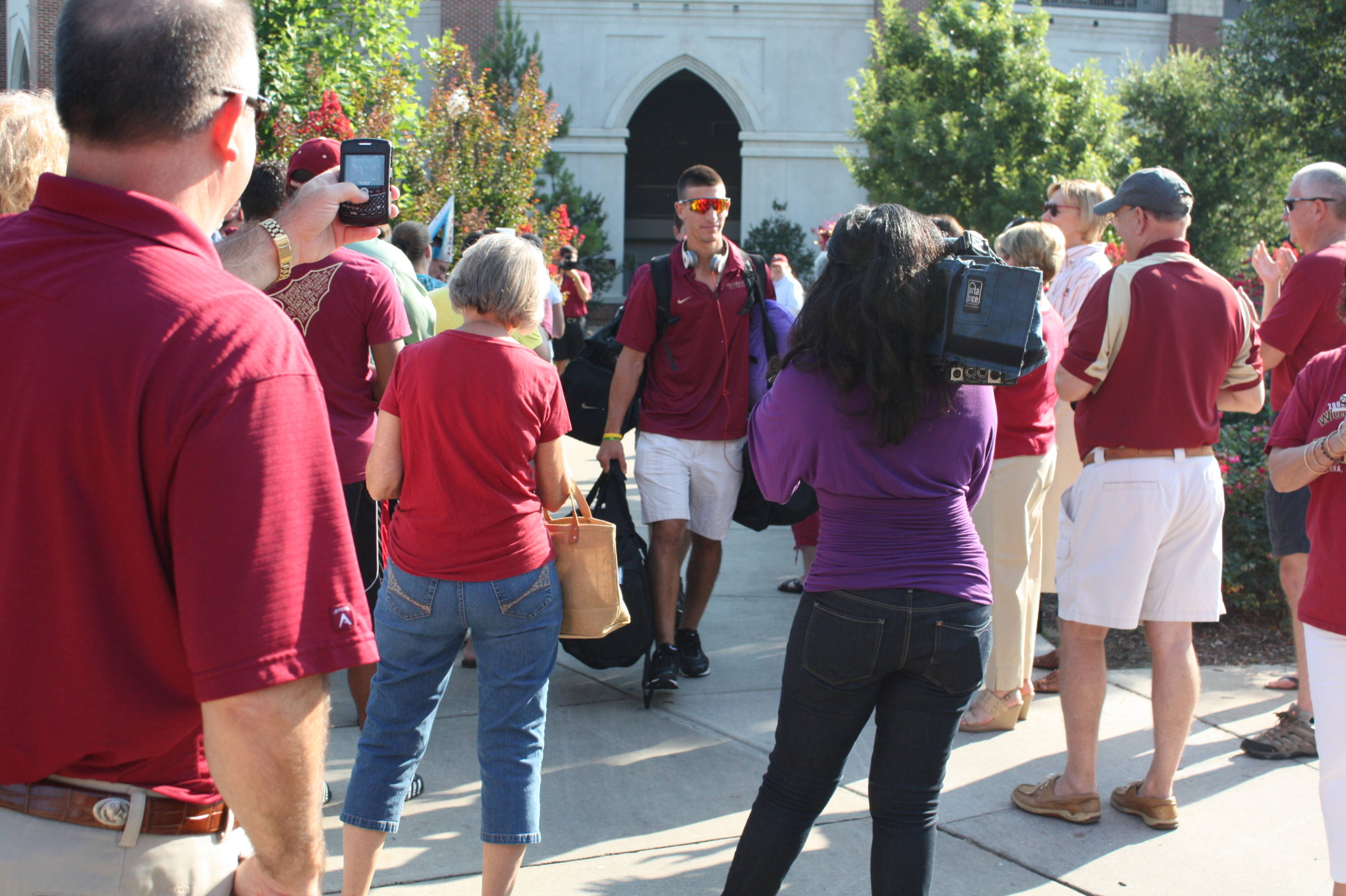 Justin Gonzalez is greeted by fans outside Dick Howser Stadium before leaving for Omaha.