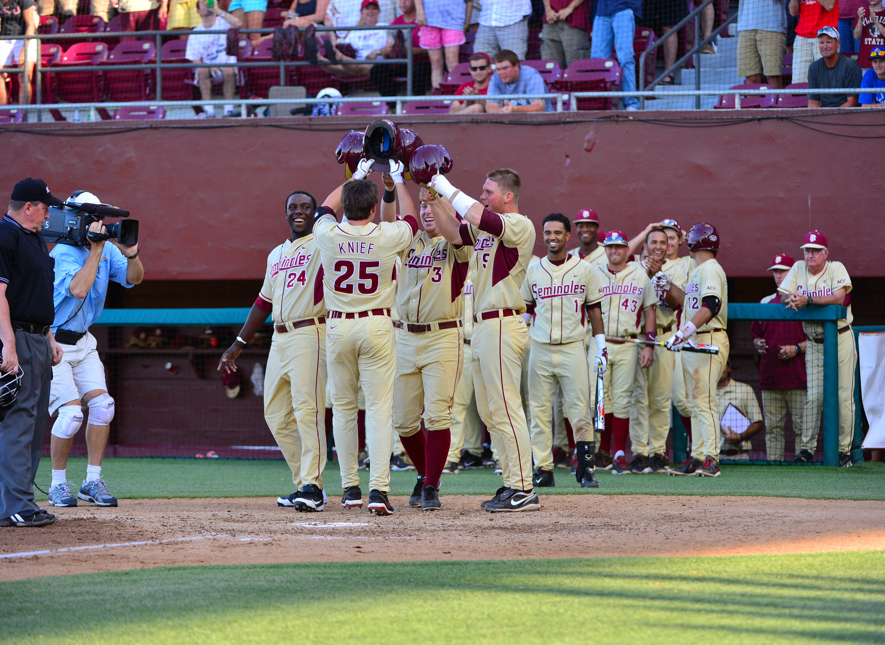 Brett Knief is met at home plate by his teammates after connecting on a grand slam in FSU's win over Troy.