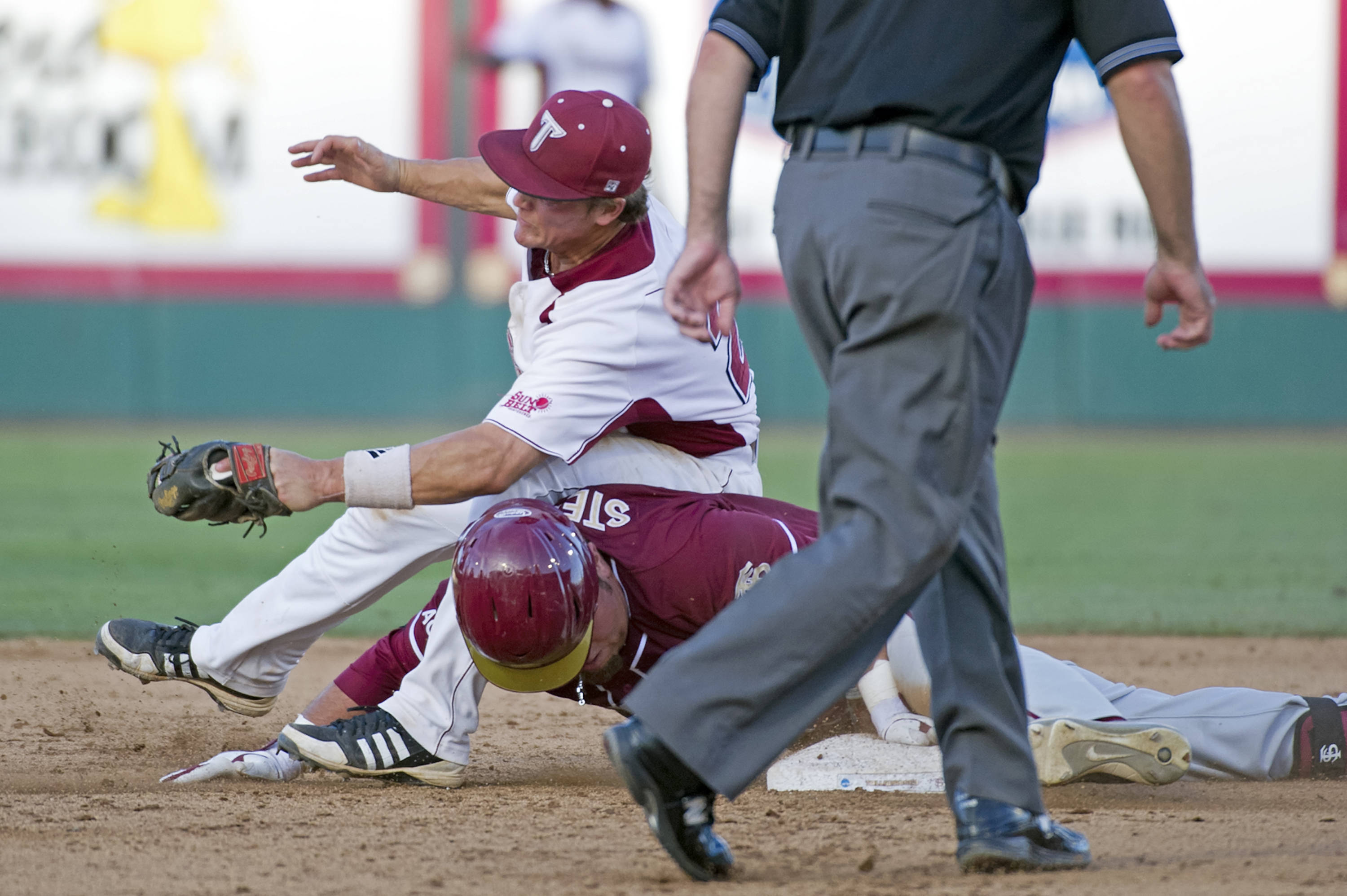 DJ Stewart (8) slides safely into second