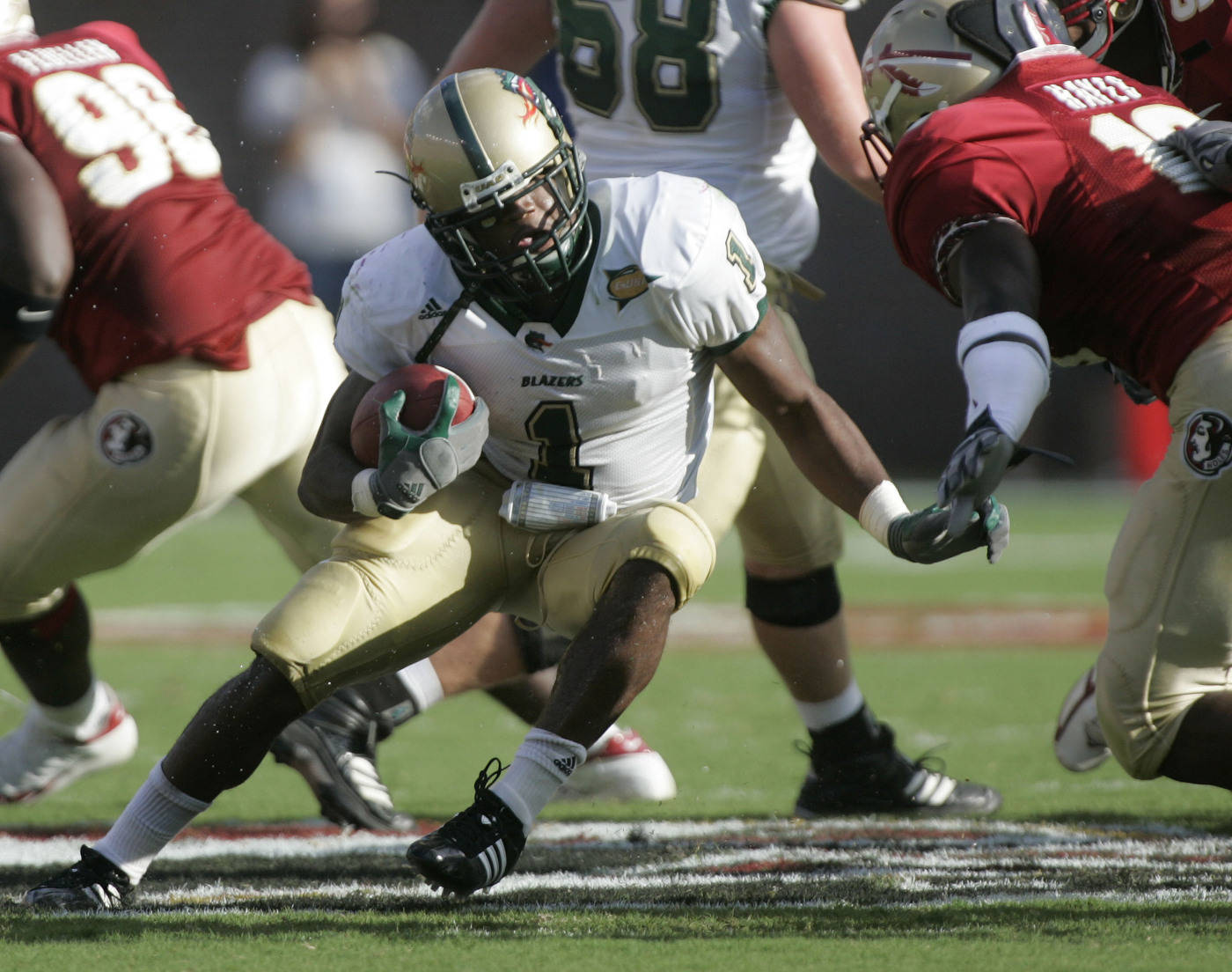 UAB running back Rashaud Slaughter, left, runs for second-quarter yardage as Florida State's Geno Hayes, right, moves in to make the tackle during a football game Saturday, Sept. 8, 2007, in Tallahassee, Fla. (AP Photo/Phil Coale)