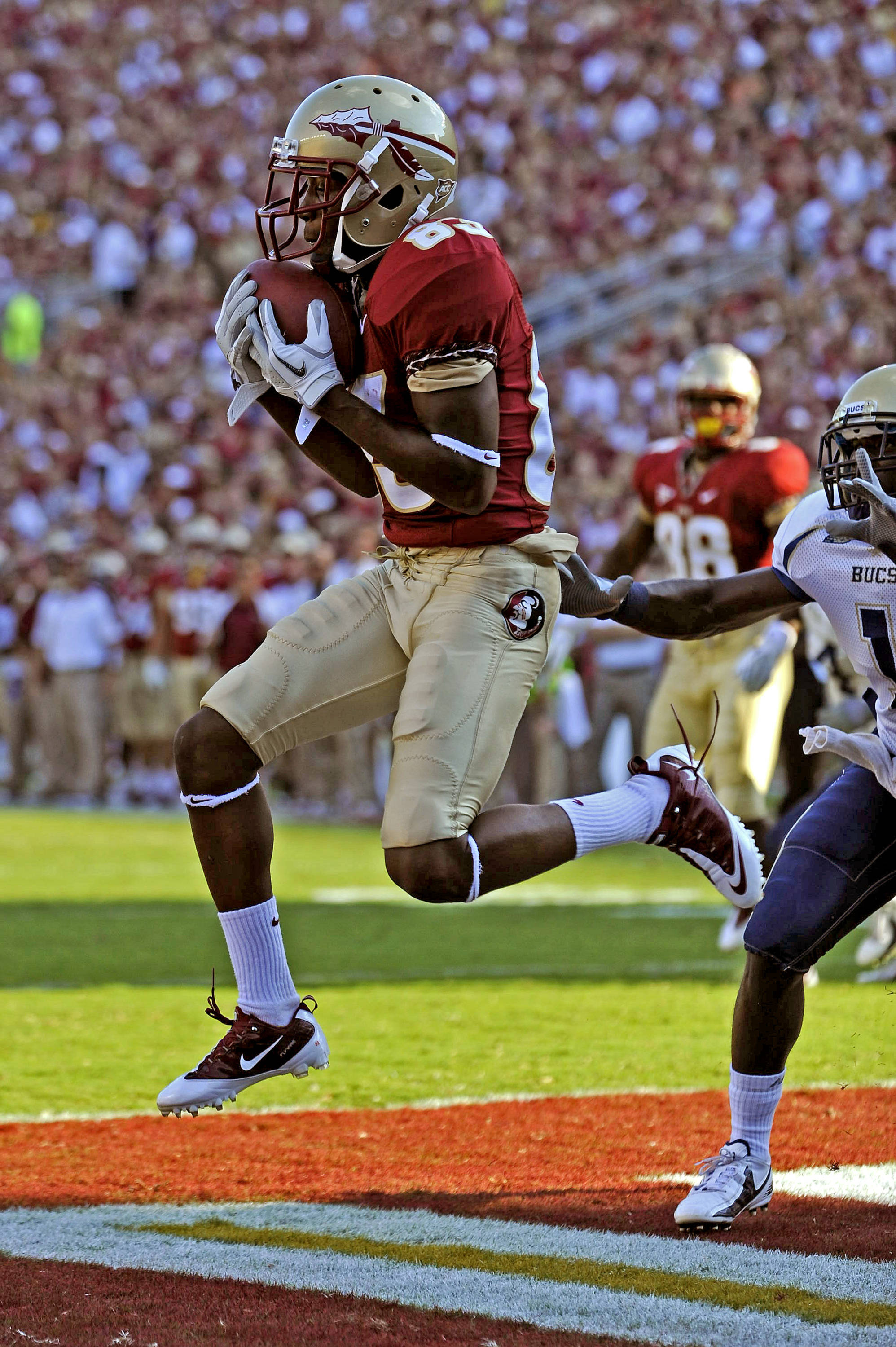 Bert Reed (83) catches a touchdown pass against Charleston Southern on September 10th.
