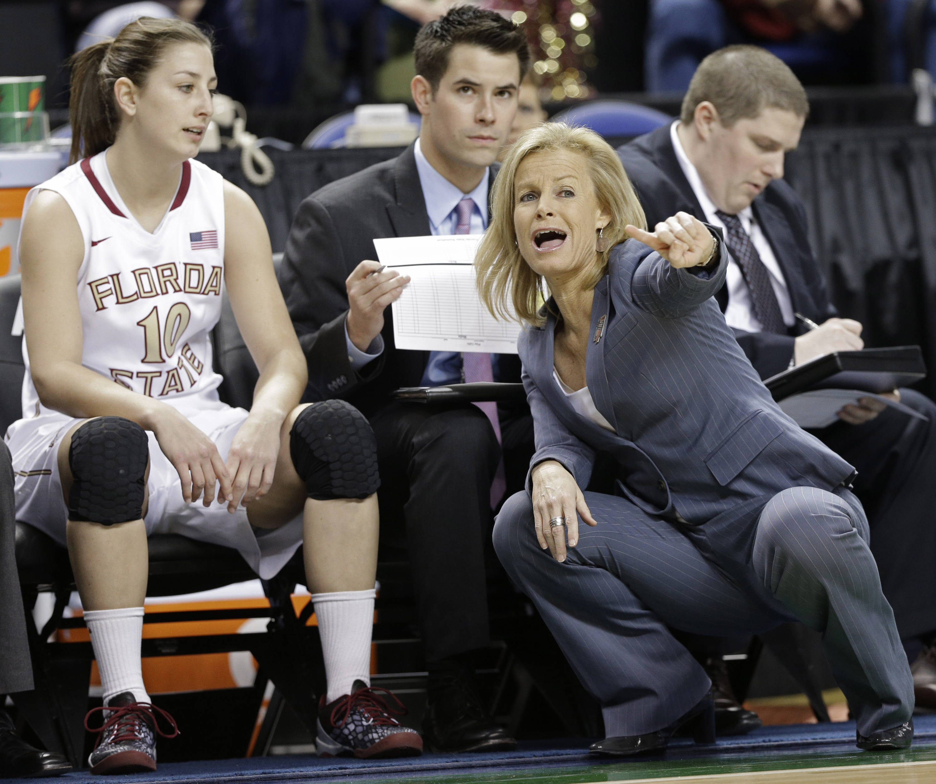 Florida State head coach Sue Semrau, right, talks with Leonor Rodriguez. (AP Photo/Chuck Burton)