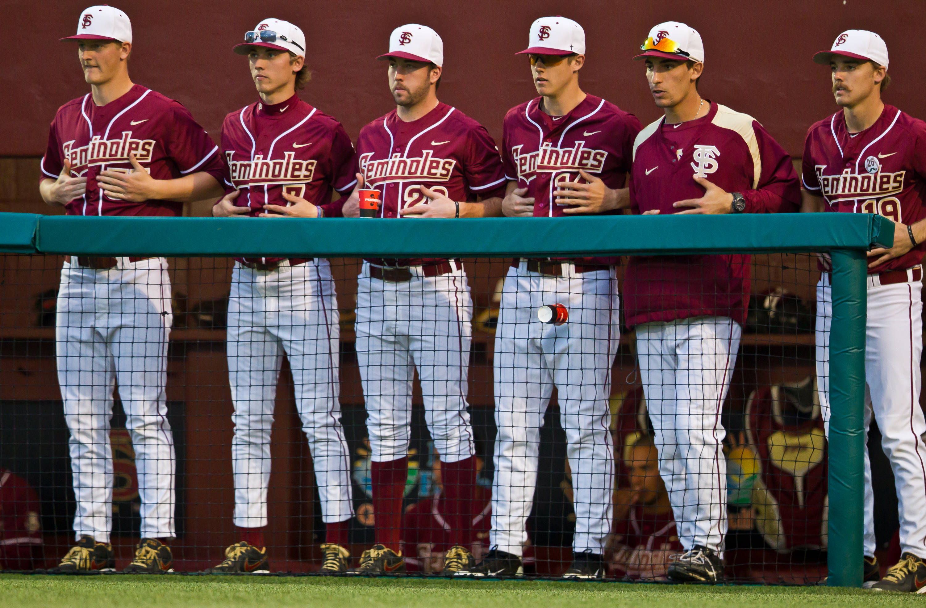 The Seminoles look on from the dugout.