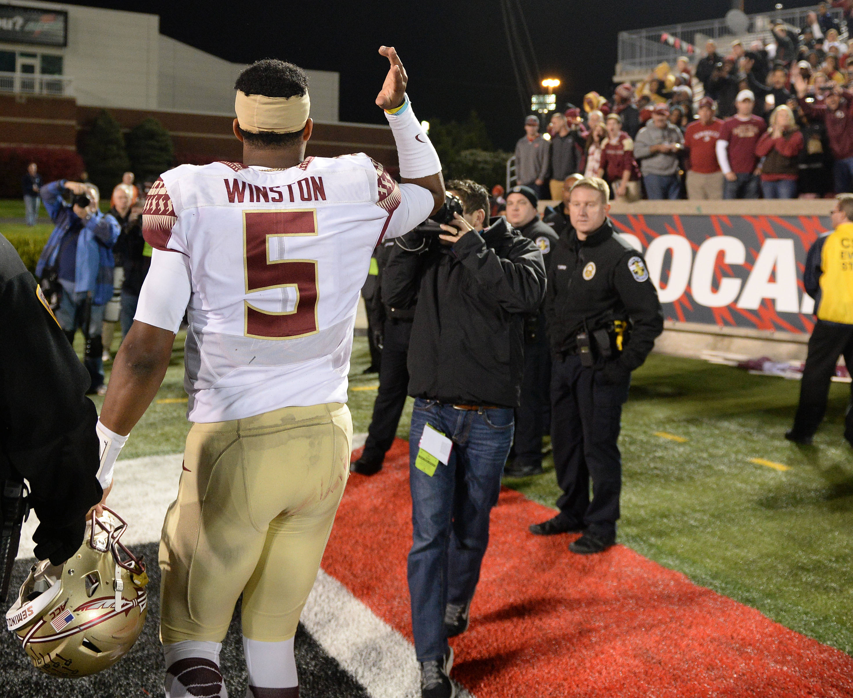 Jameis Winston does the chop while walking off the field