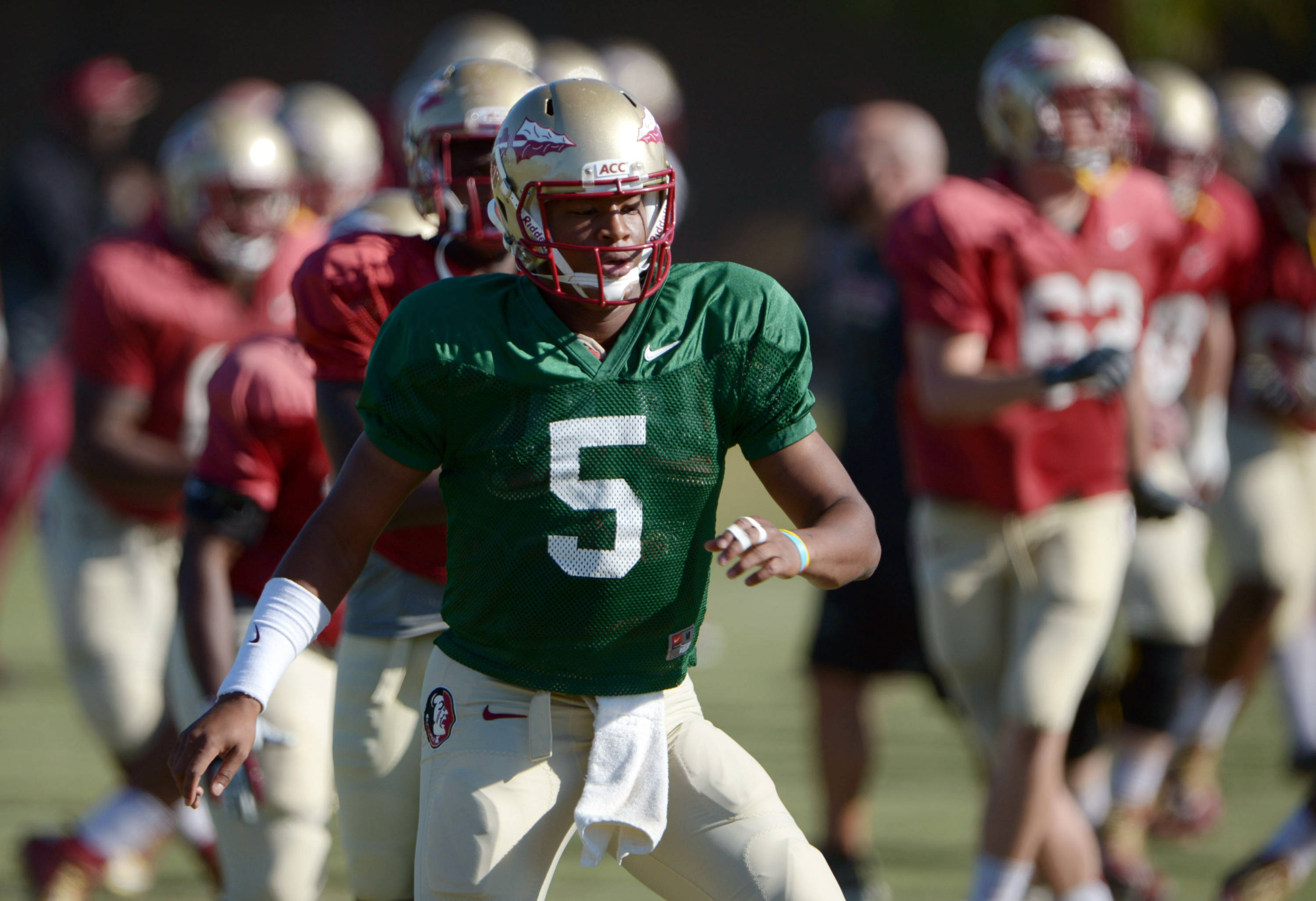 Florida State Seminoles quarterback Jameis Winston (5) stretches at practice for the 2014 BCS National Championship against the Auburn Tigers. Mandatory Credit: Kirby Lee-USA TODAY Sports