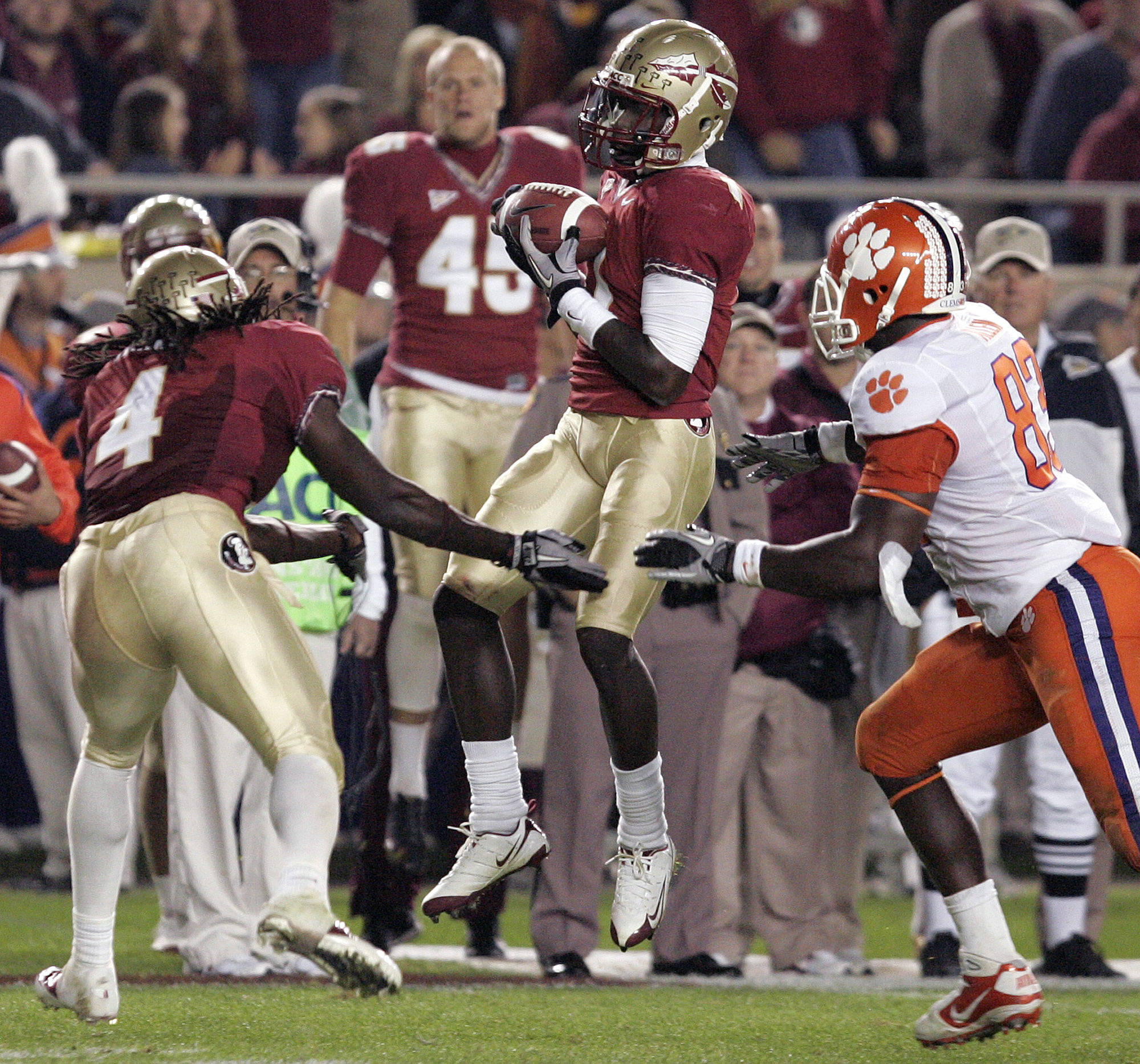 Florida State's Michael Harris, center, comes down with an interception off of Clemson's Kyle Parker in the second quarter of an NCAA college football game on Saturday, Nov. 13, 2010, in Tallahassee, Fla. (AP Photo/Steve Cannon)