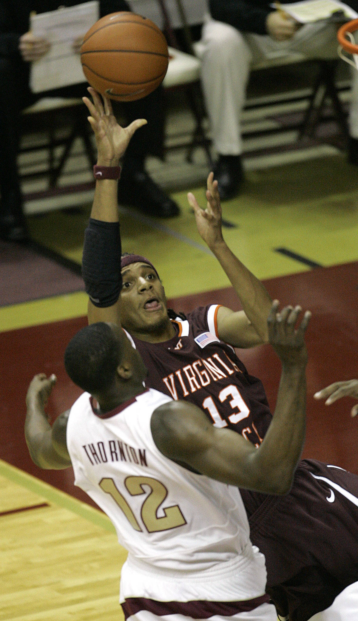 Virginia Tech's Deron Washington, right, shoots as Florida State's Al Thornton defends during the first half of a college basketball game, Wednesday, Jan. 17, 2007, in Tallahassee, Fla. (AP Photo/Phil Coale)