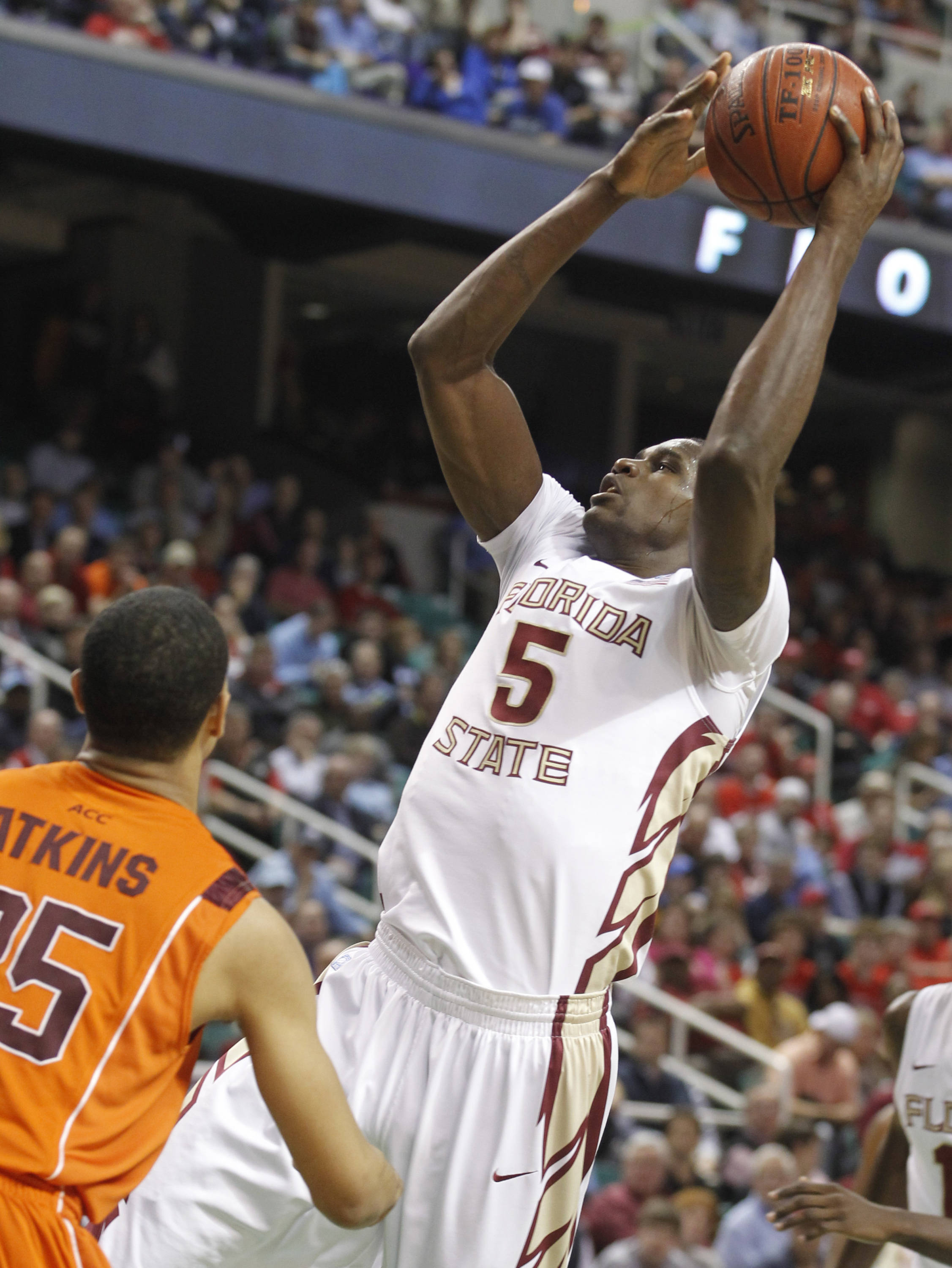 Florida State's Bernard James shoots over Virginia Tech's Manny Atkins in the first half. (AP Photo/Bob Leverone)