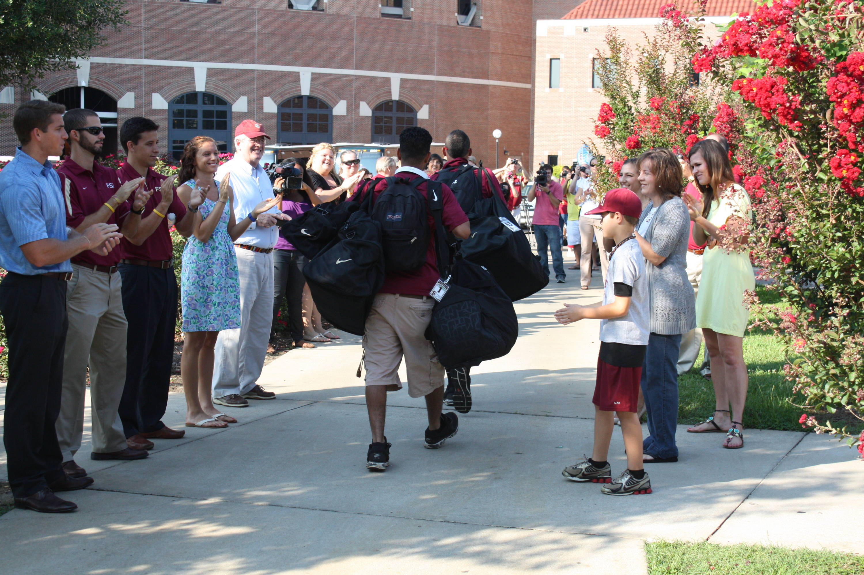 Fans cheering on the team outside Dick Howser Stadium.