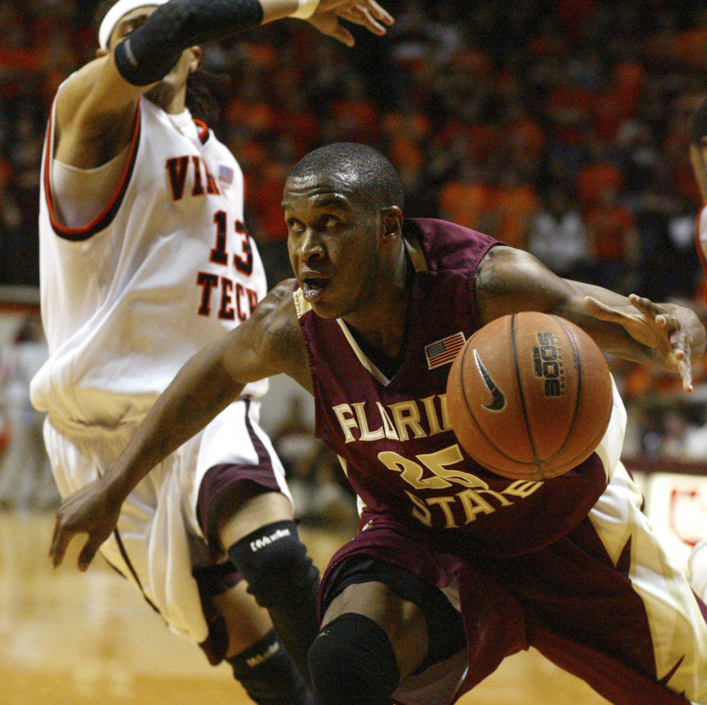Florida State's Jason Rich (25) looks to score past Virginia Tech's Deron Washington, left, during the first half of a college basketball game in Blacksburg, Va., Tuesday, Jan. 29, 2008.