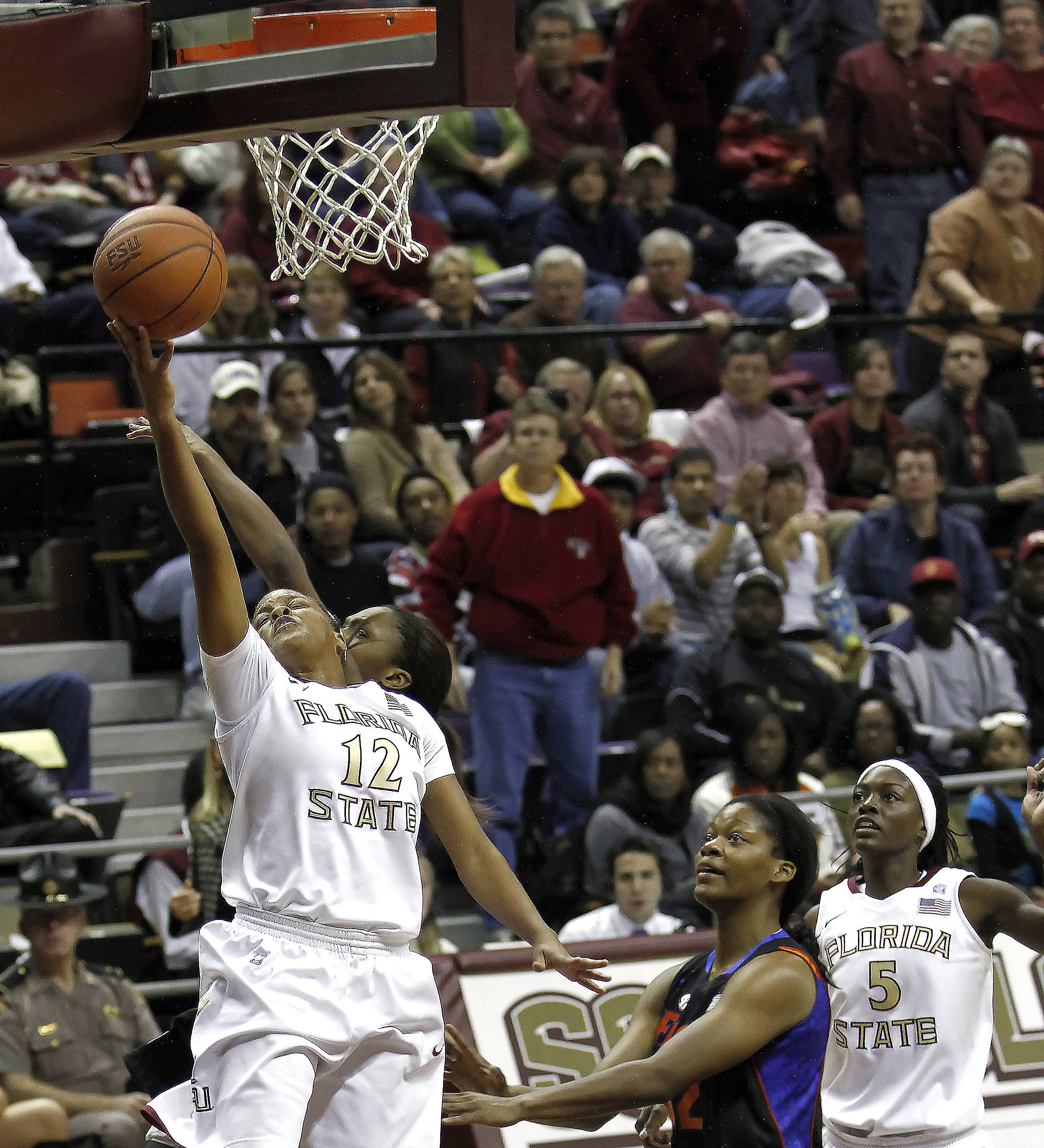 FSU vs Florida 12/28/10 - Courtney Ward (12), Christian Hunnicutt (5)#$%^Photo by Steve Musco