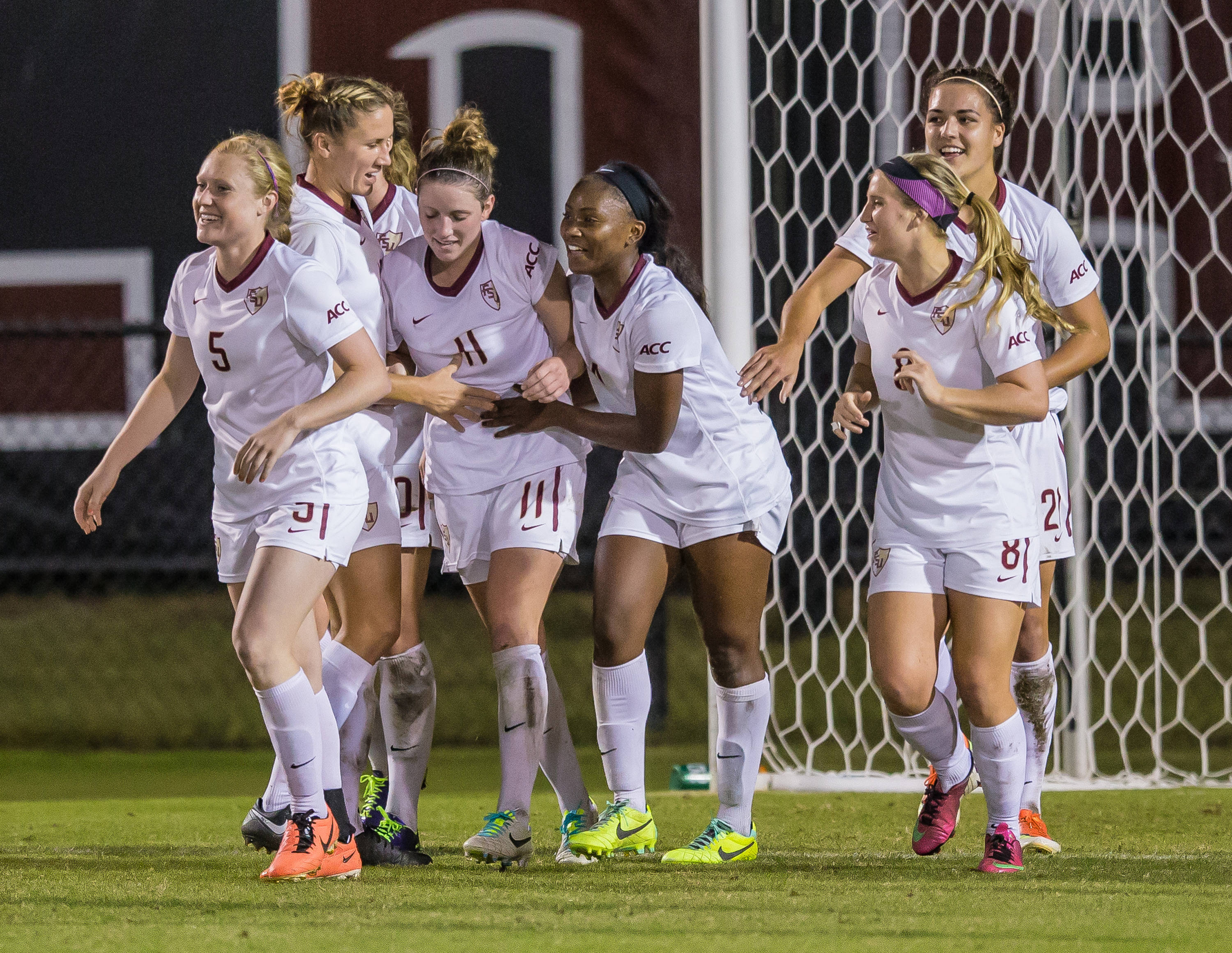 Noles celebrate after Isabella Schmid (11) scores FSU's second goal.