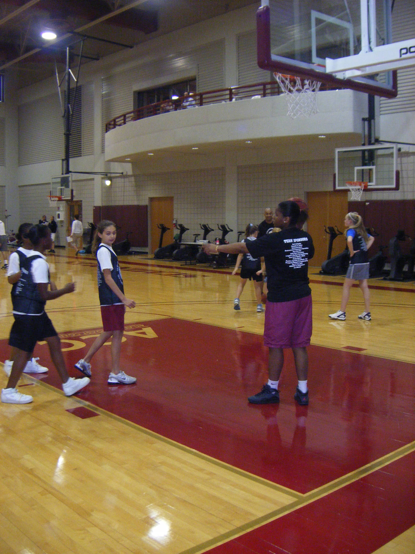 Antionette Howard teaching the girls how to shoot a lay-up.