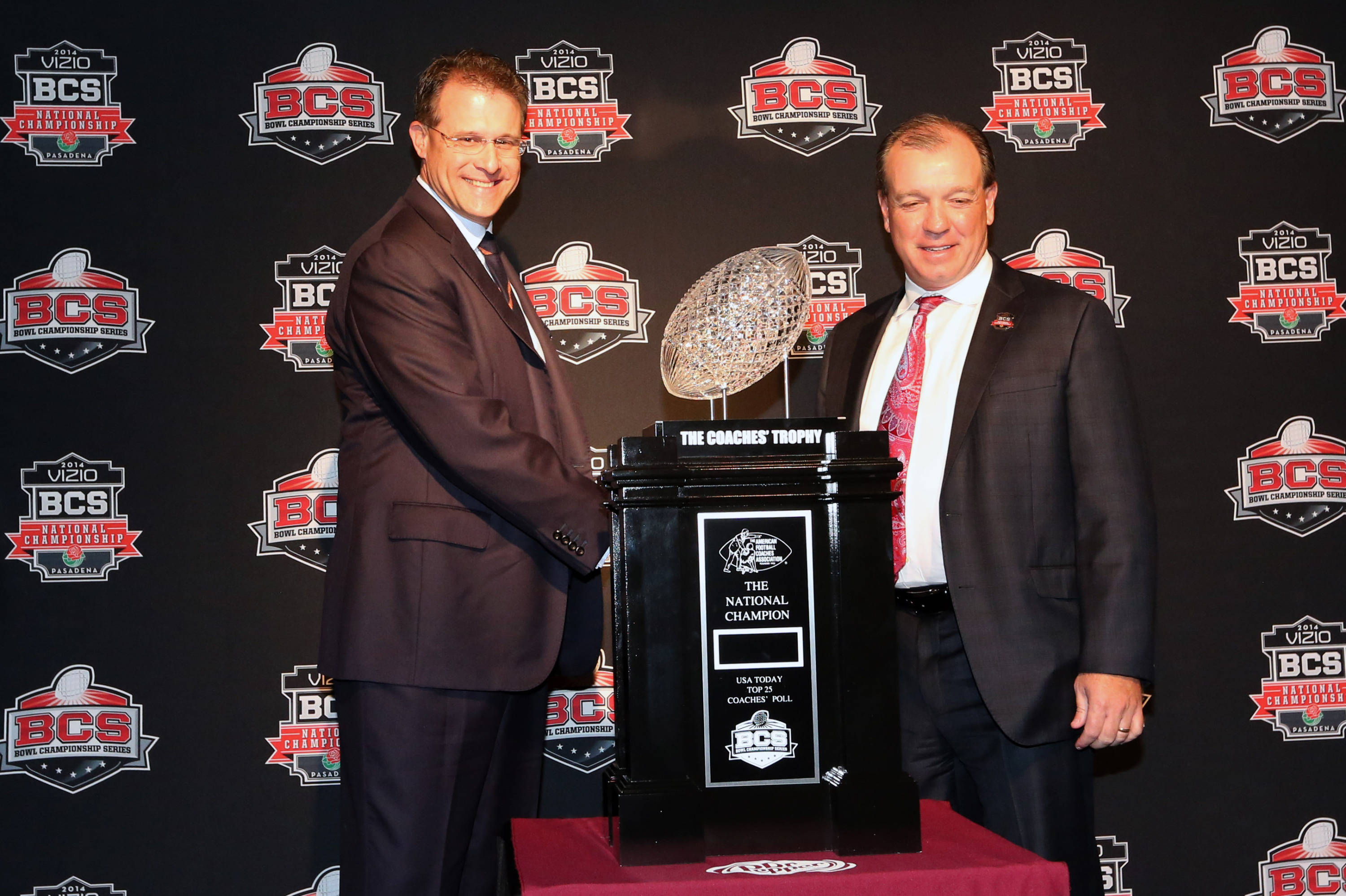 Jan 5, 2014; Los Angeles, CA, USA; Auburn Tigers head coach Gus Malzahn (left) and Florida State Seminoles head coach Jimbo Fisher pose for photos with the Coaches' Trophy at Newport Beach Marriott. Mandatory Credit: Matthew Emmons-USA TODAY Sports