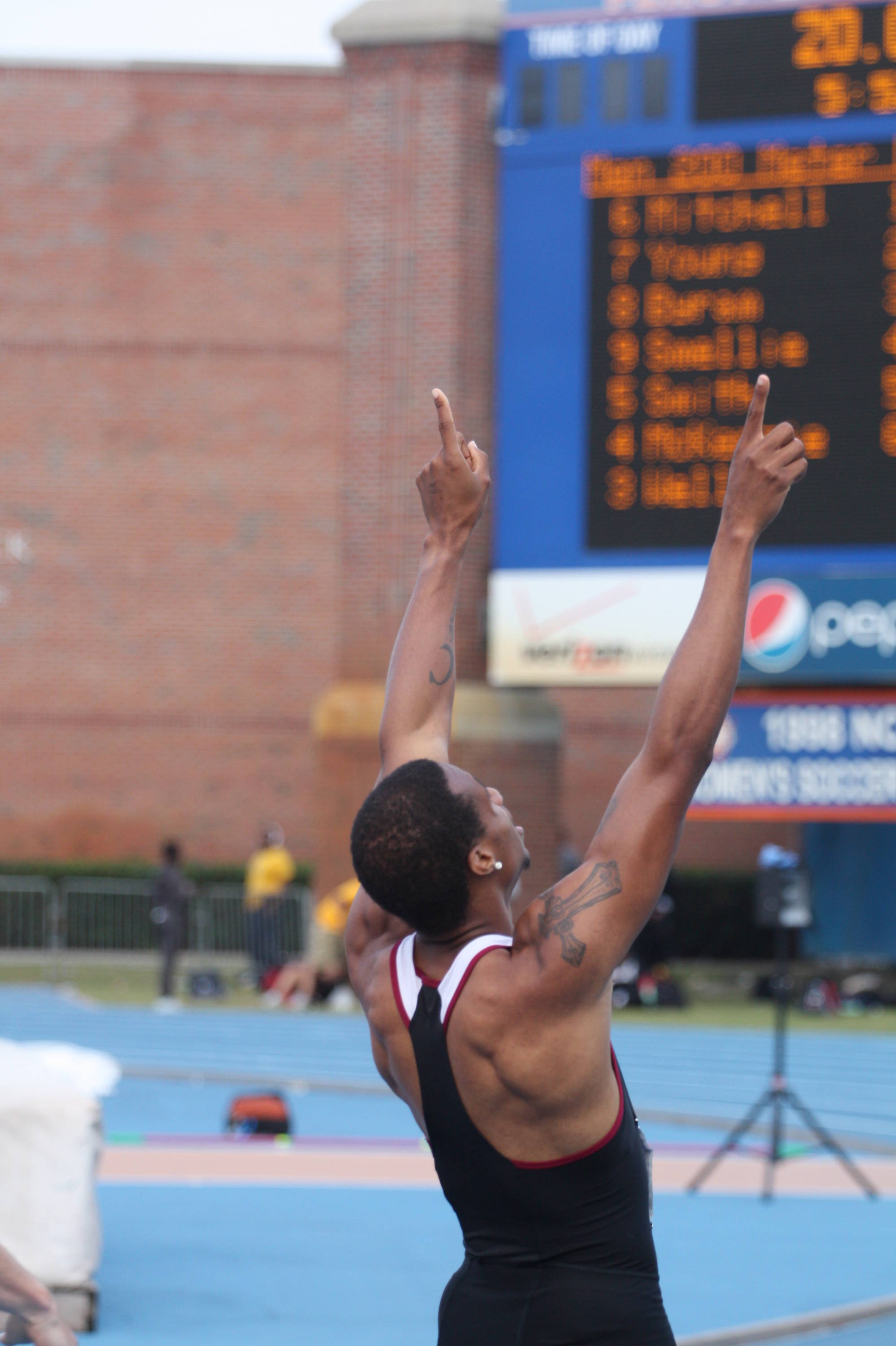 Maurice Mitchell gives praise after winning the 200-meter dash.