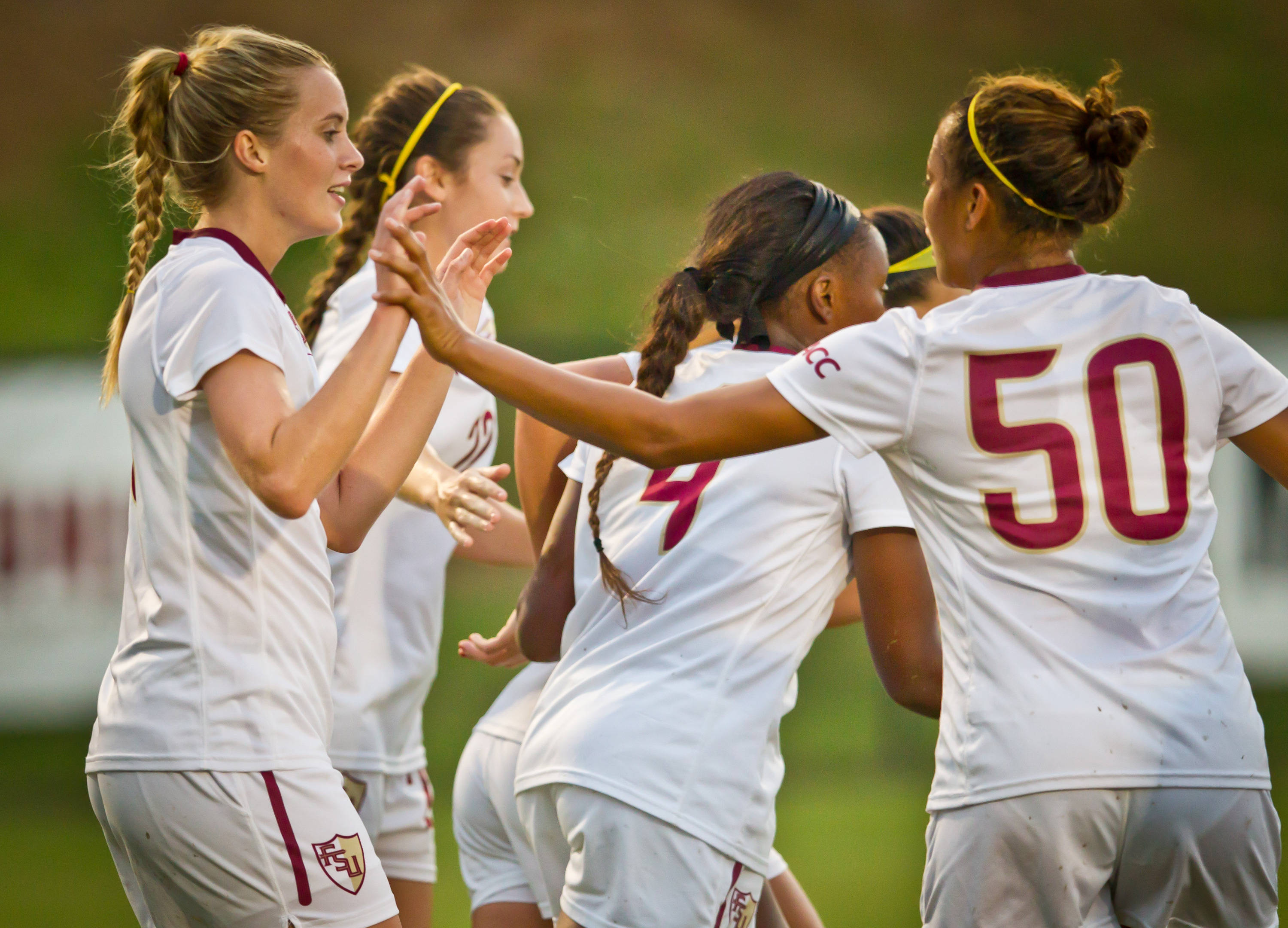 The Seminoles celebrate after a goal by Berglind Thorvaldsdottir