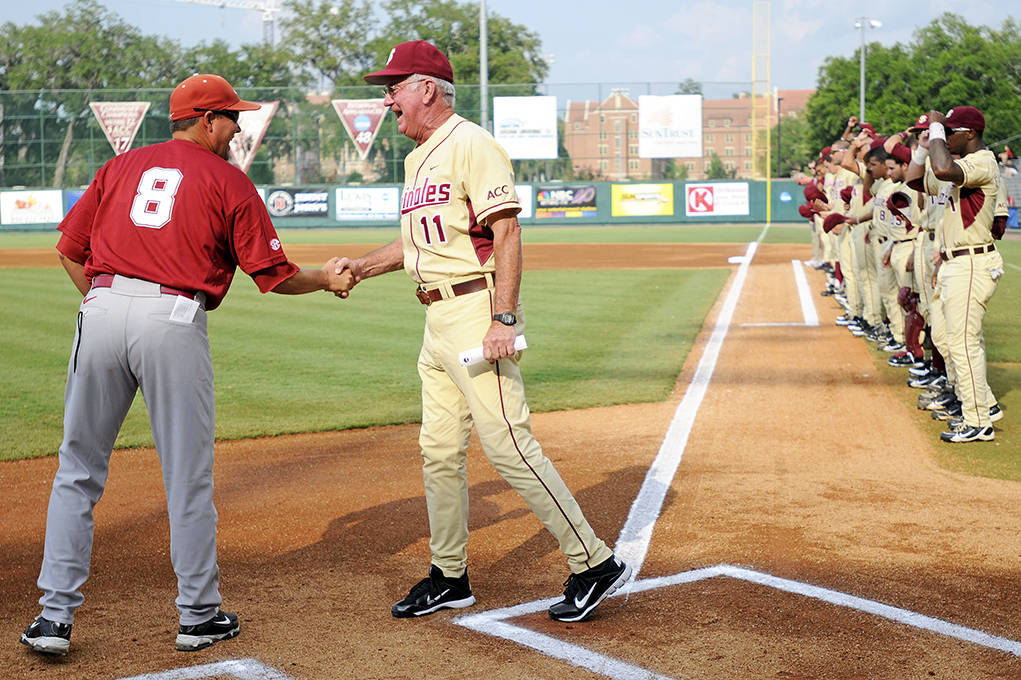 Mike Martin (11) and Alabama Head Coach Mitch Gaspard meet at home plate