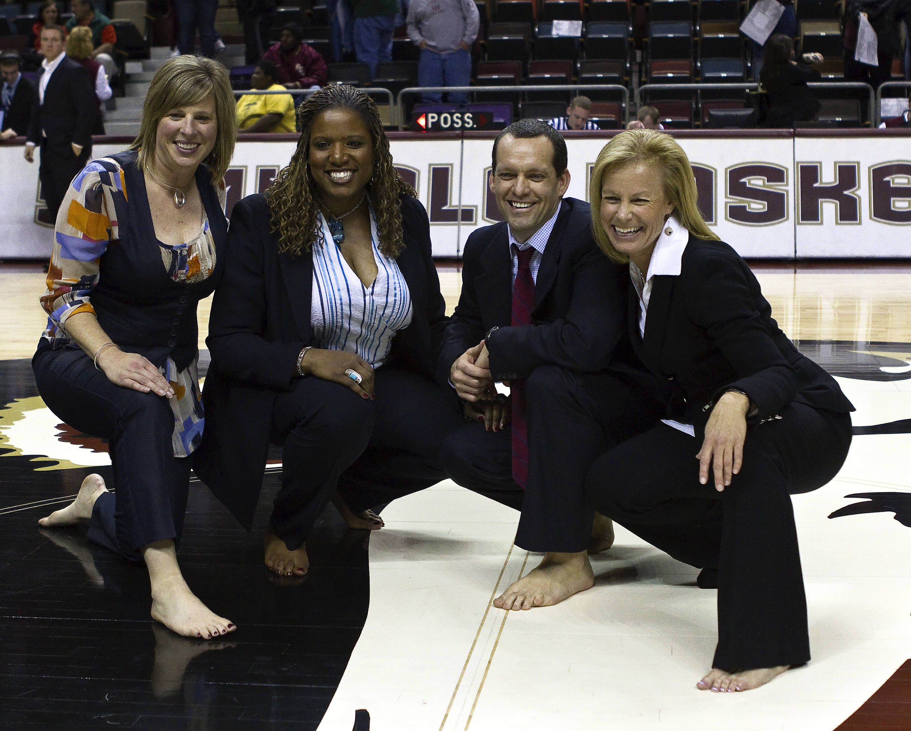 FSU vs Miami - 01/24/11 - Shoeless Coach Cori Close, Coach Angie Johnson, Coach Lance White and Head Coach Sue Semrau