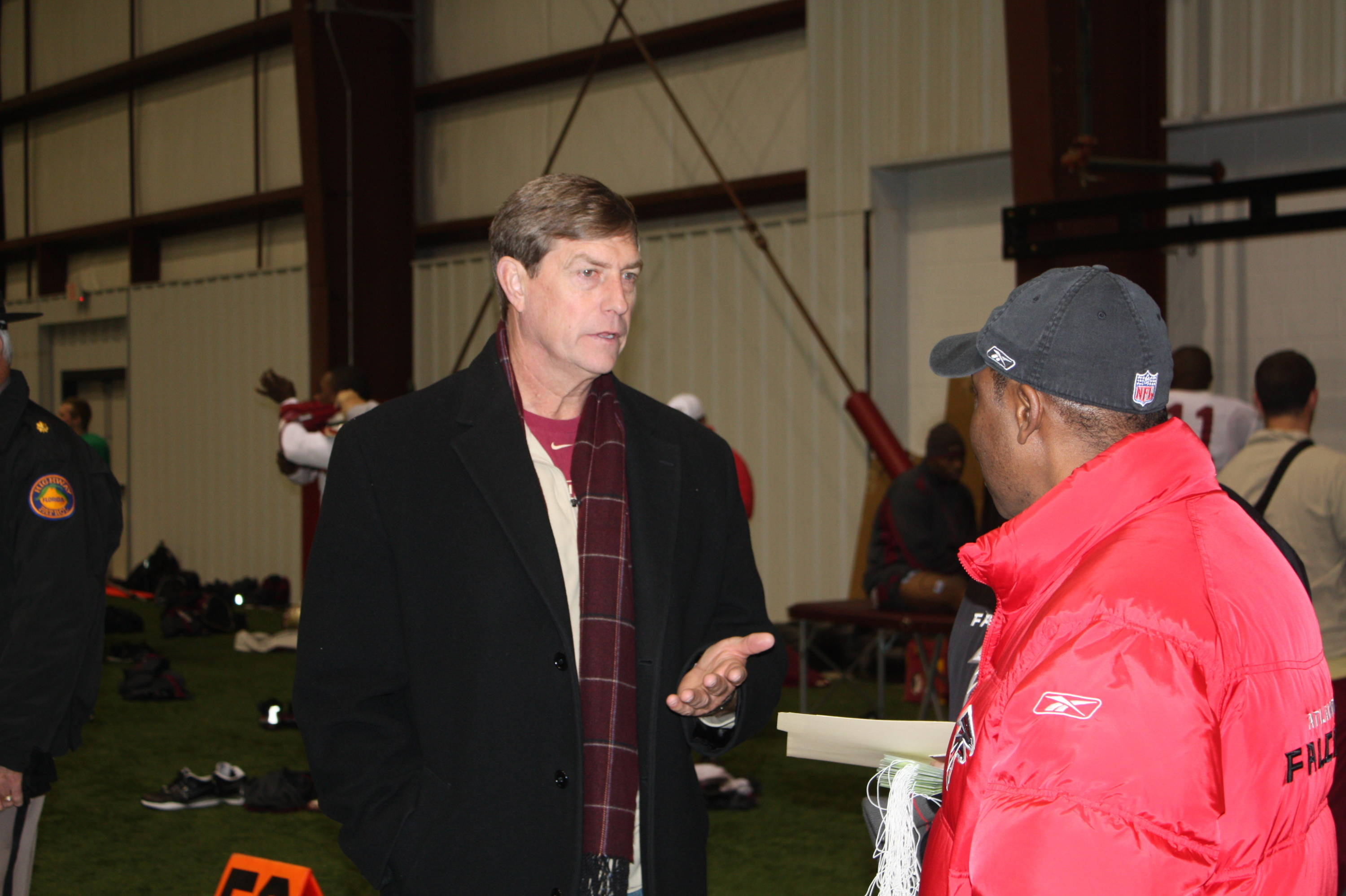FSU Director of Athletics Randy Spetman talks to a member of the Atlanta Falcons staff.