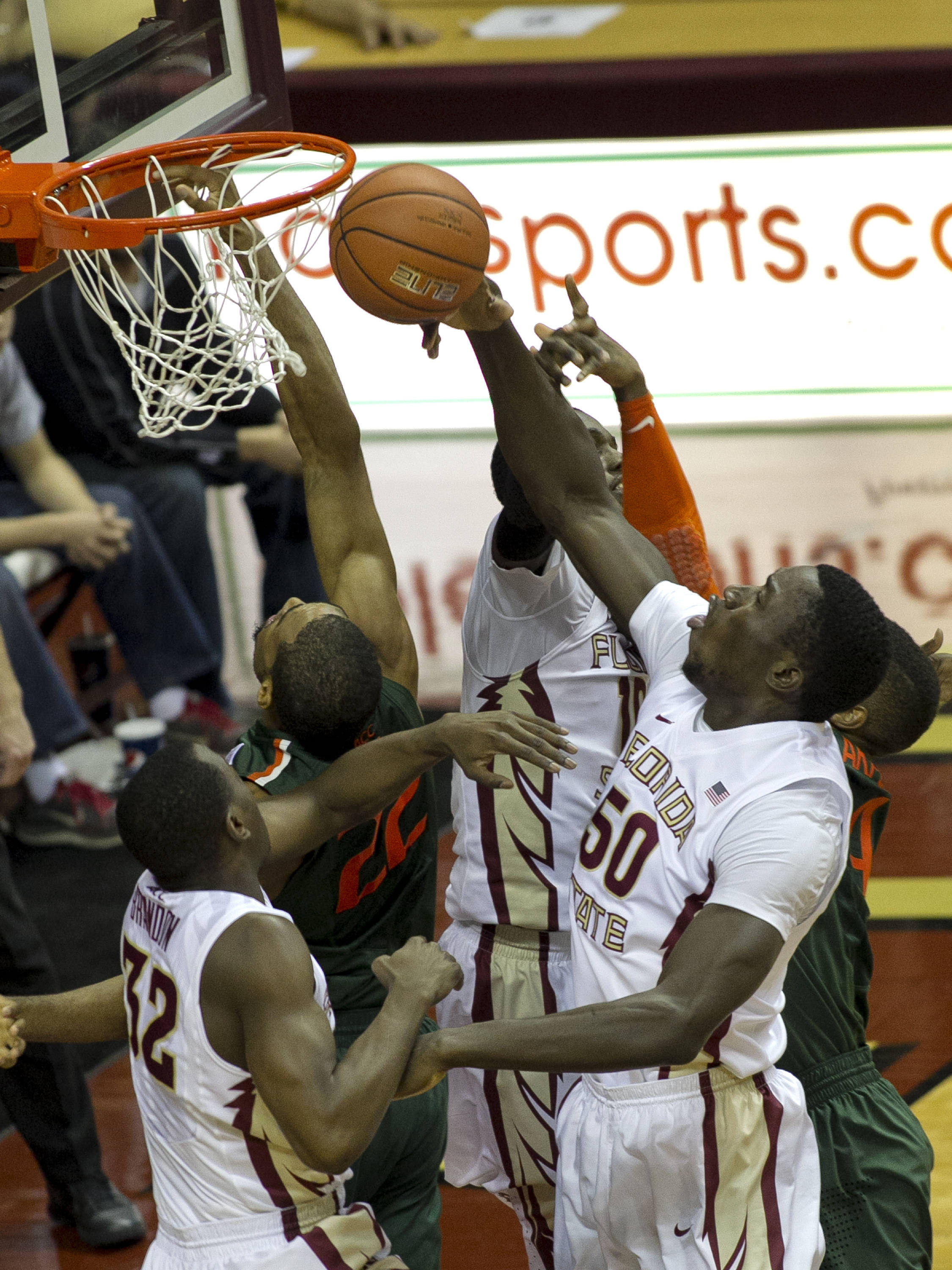 Michael Ojo (50)  fights for an early rebound, FSU vs Miami, 2-10-14, (Photo's by Steve Musco)