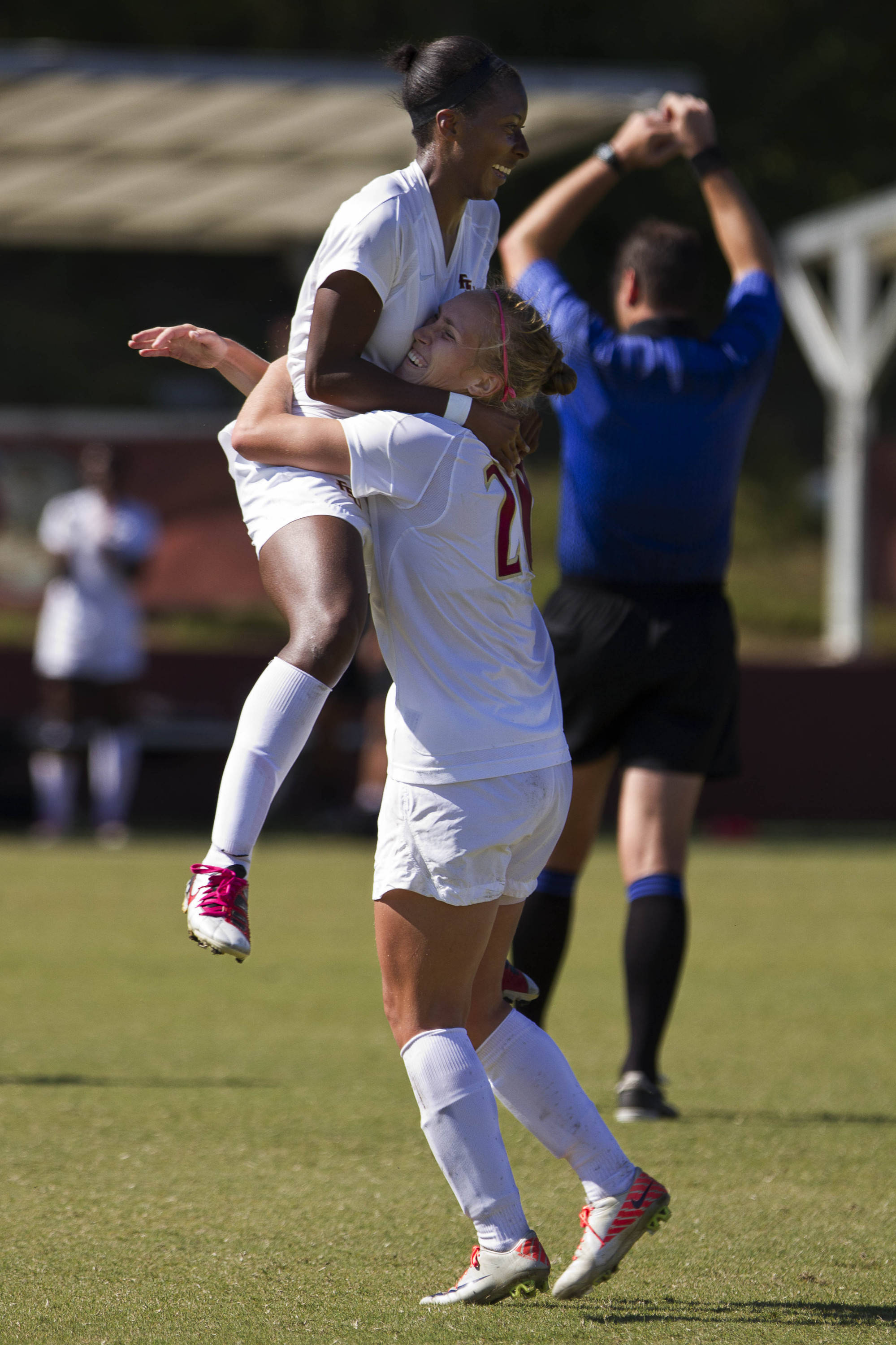 Tiffany McCarty (14) and Janice Cayman (20) celebrate after McCarthy's goal against Miami.