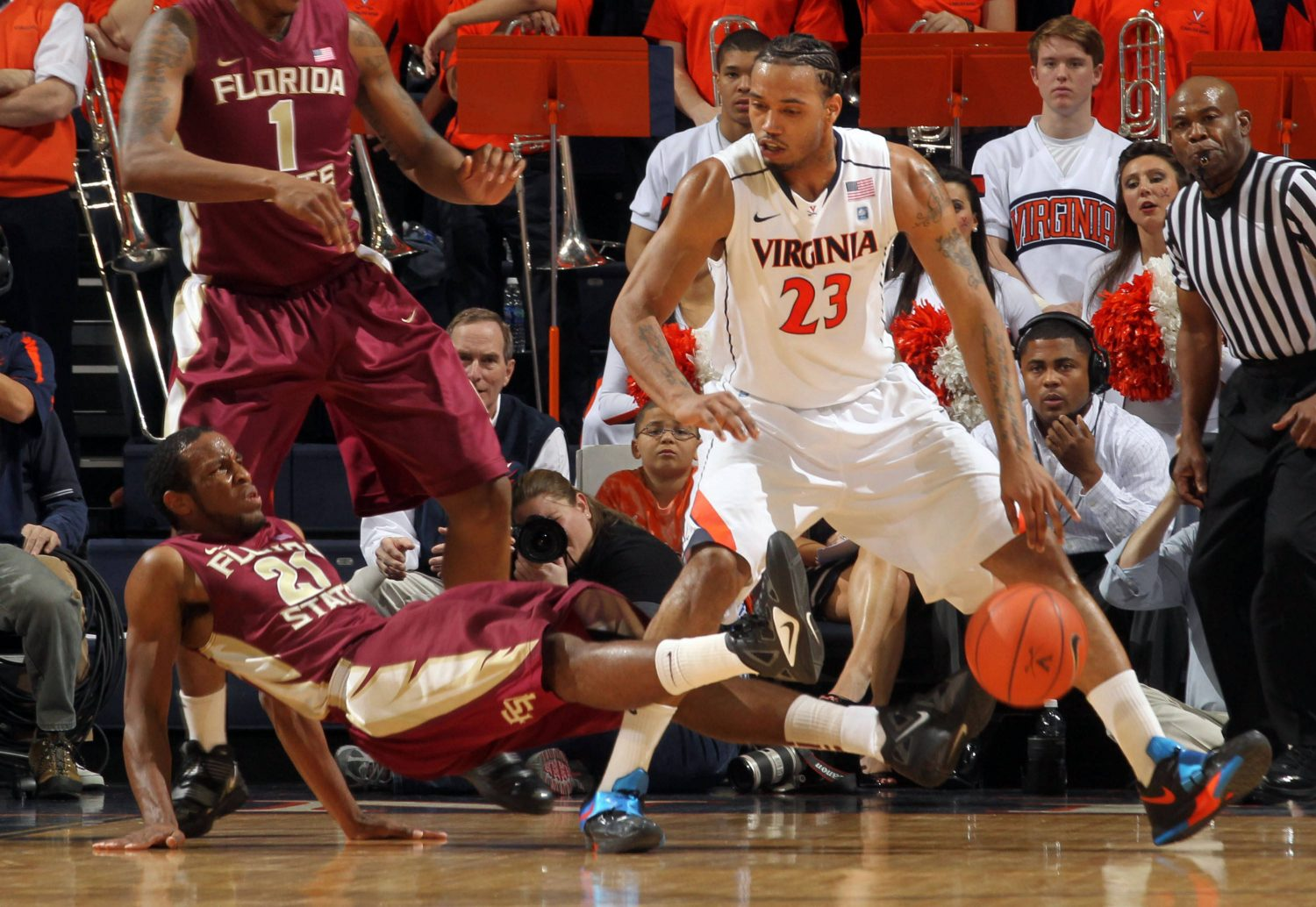 Florida State guard Michael Snaer draws an offensive foul from Virginia forward Mike Scott during the first half. (AP Photo/Andrew Shurtleff)