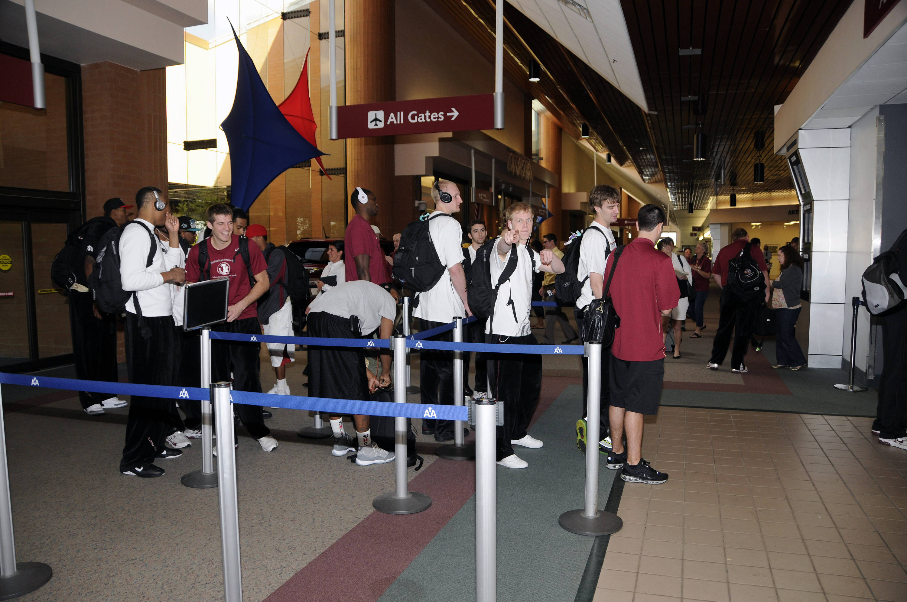 Florida State players go through security at the Tallahassee Airport