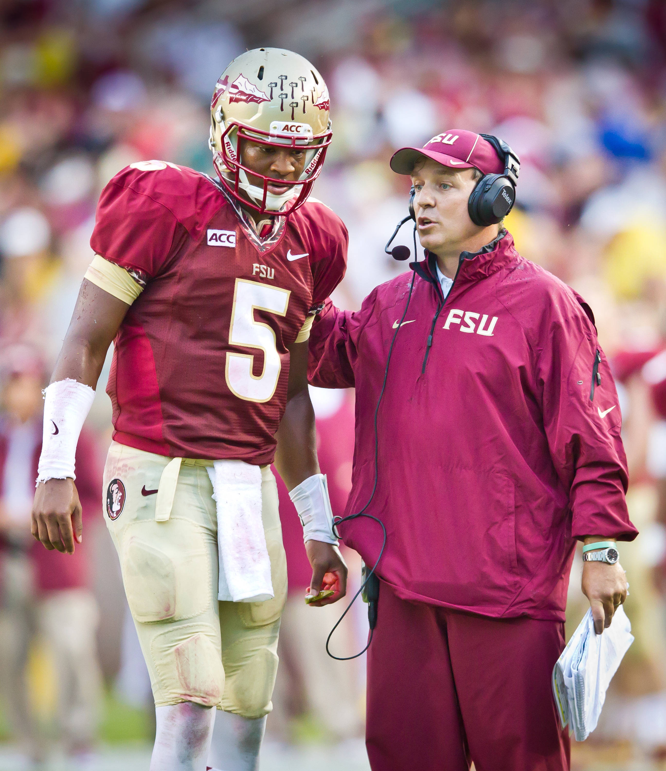 Jameis Winston (5) gets the play from Jimbo Fisher.