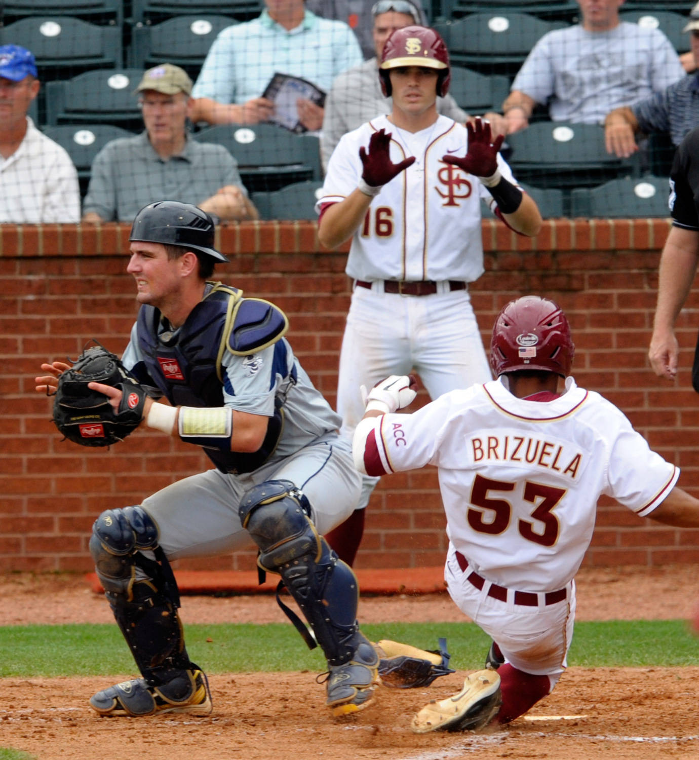 Florida State's Jose Brizuela (53) slides into homebase as Georgia Tech's A.J. Murray (9) waits for the ball and Florida State's Jace Boyd (16) tells Brizuela to get down during the ACC Baseball Championship May 23, 2012 in Greensboro, N.C. (Photo by Sara D. Davis/theACC.com)