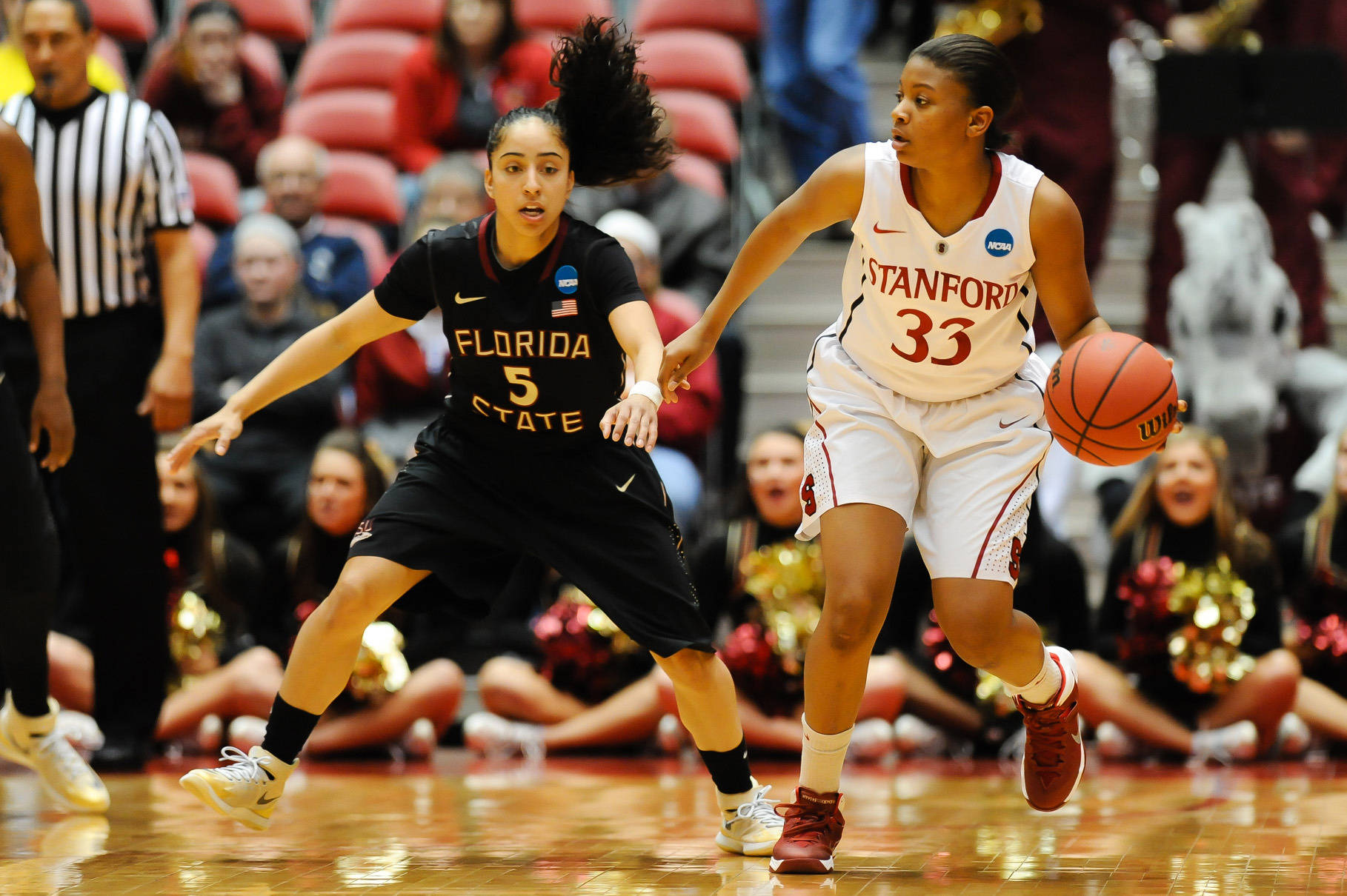 Mar 24, 2014; Ames, IA, USA; Stanford Cardinal guard Amber Orrange (33) looks to pass around Florida State Seminoles guard Cheetah Delgado (5) in the first half of a women's college basketball game in the second round of the NCAA Tournament at James H. Hilton Coliseum. Mandatory Credit: Steven Branscombe-USA TODAY Sports