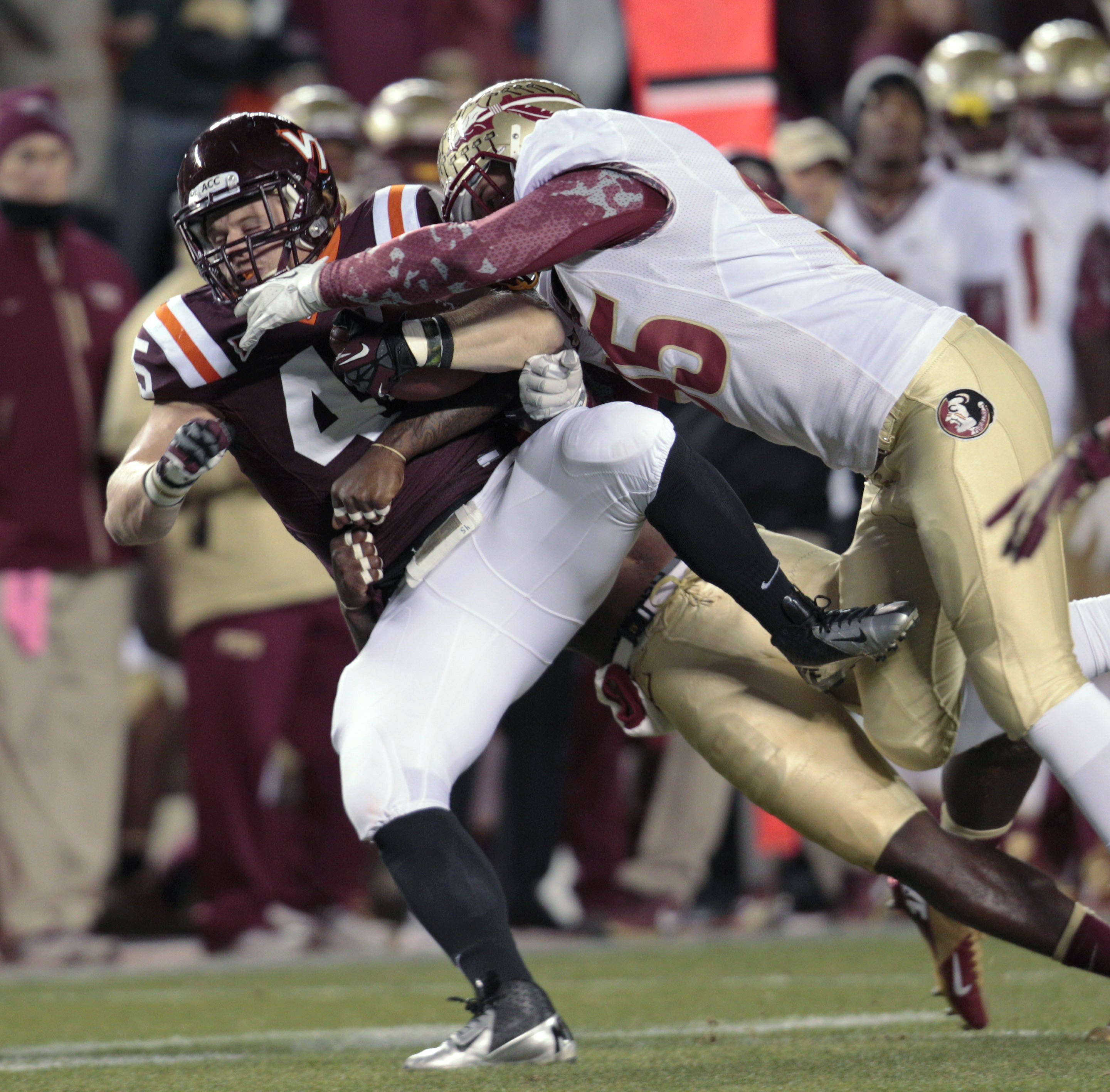 Virginia Tech fullback Joey Phillips (45) gains a few yards against Florida State defensive end Bjoern Werner (95). (AP Photo/Steve Helber)