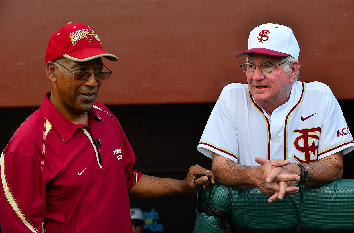 Head coach Mike Martin talks with Fred Flowers before the start of Friday's game.