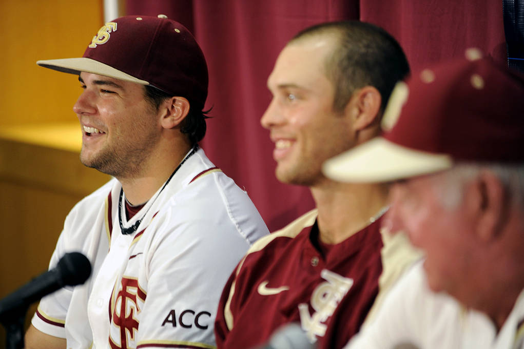 Mike Martin (11), Scott Sitz (26), Mike McGee (25) at the postgame press conference