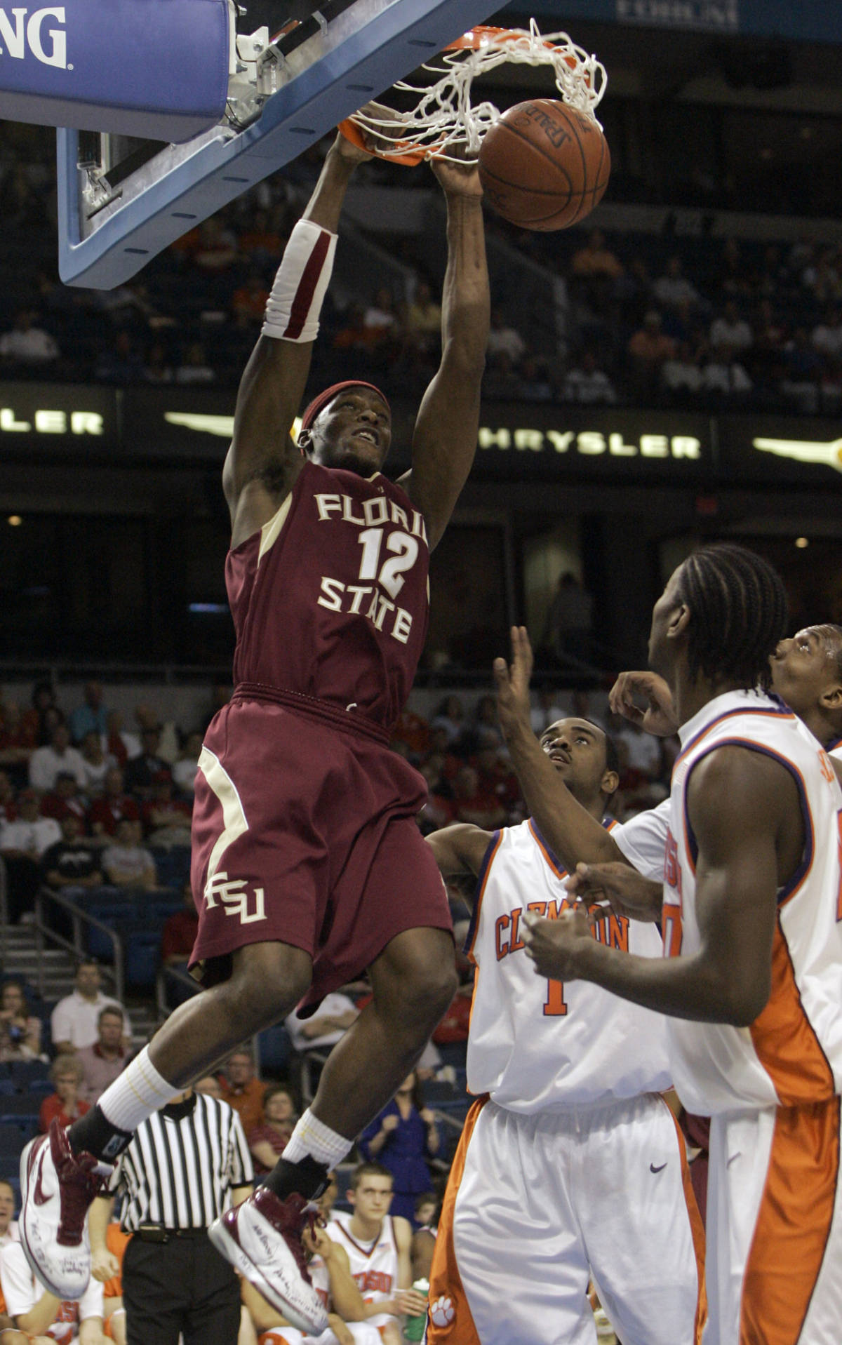 Florida State's Al Thornton (12) dunks over Clemson's K.C. Rivers (1) during the fiirst half of a first round game of the Men's Atlantic Coast Conference basketball tournament in Tampa, Fla., Thursday, March 8, 2007. (AP Photo/John Raoux)