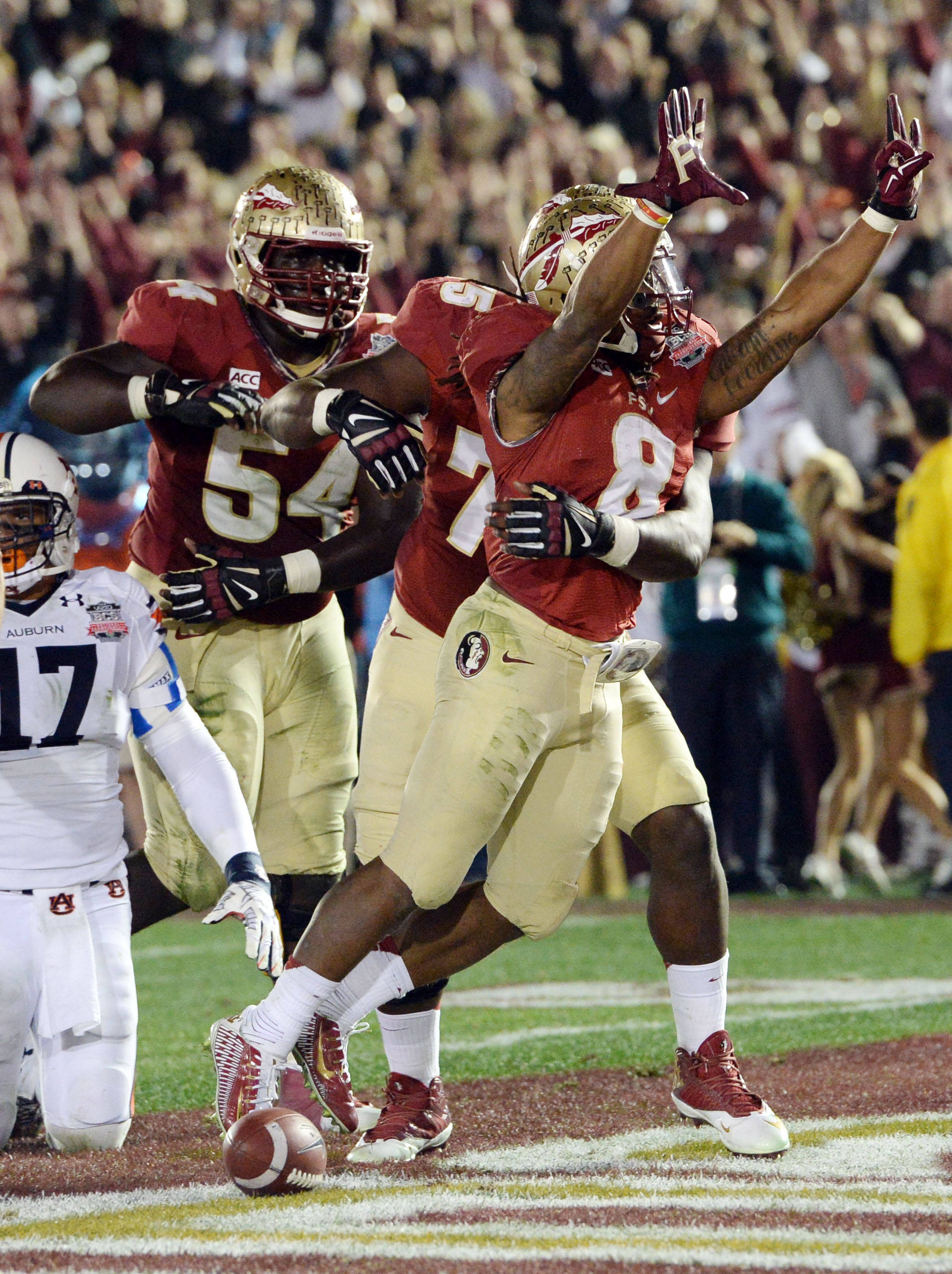Jan 6, 2014; Pasadena, CA, USA; Florida State Seminoles running back Devonta Freeman (8) celebrates with teammates after scoring a touchdown against the Auburn Tigers during the first half of the 2014 BCS National Championship game at the Rose Bowl.  Mandatory Credit: Jayne Kamin-Oncea-USA TODAY Sports