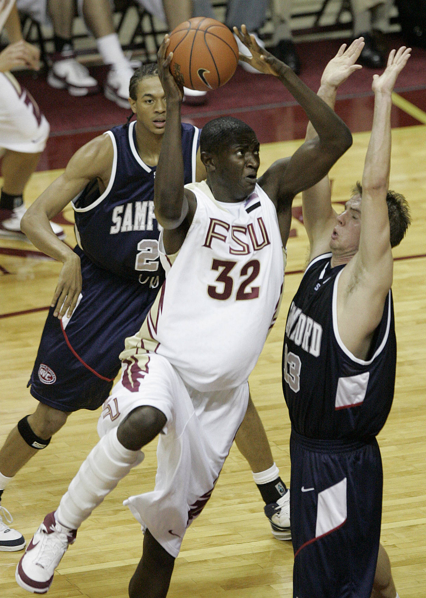 Florida State's Solomon Alabi (32) drives against Samford's Bryan Friday in the second half of a college basketball game which FSU won 61-45 on Sunday, Dec. 2, 2007, in Tallahassee, Fla. (AP Photo/Steve Cannon)