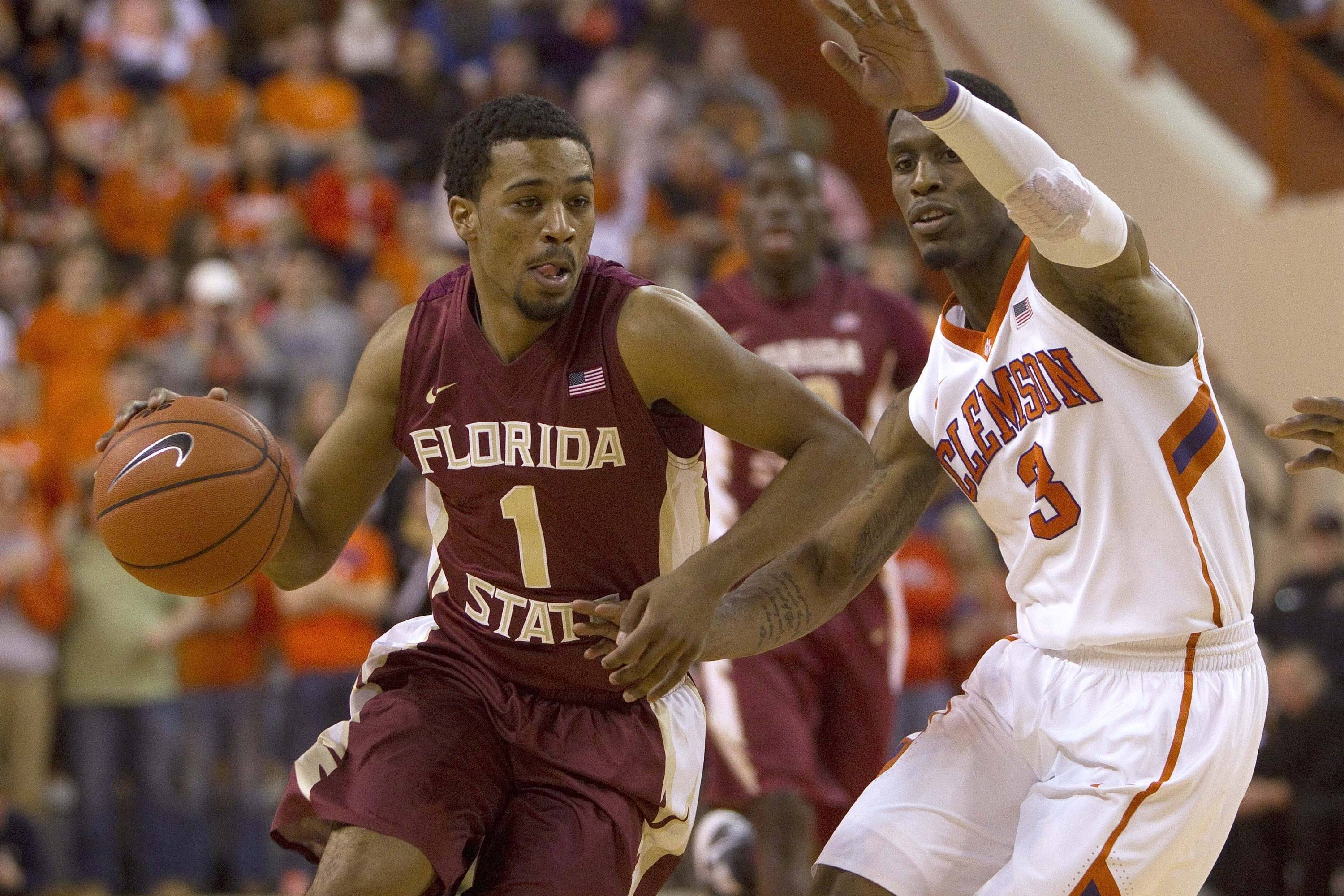 Jan 9, 2014; Clemson, SC, USA; Florida State Seminoles guard Devon Bookert (1) drives to the basket while being defended by Clemson Tigers guard Adonis Filer (3) during the first half at J.C. Littlejohn Coliseum. Mandatory Credit: Joshua S. Kelly-USA TODAY Sports