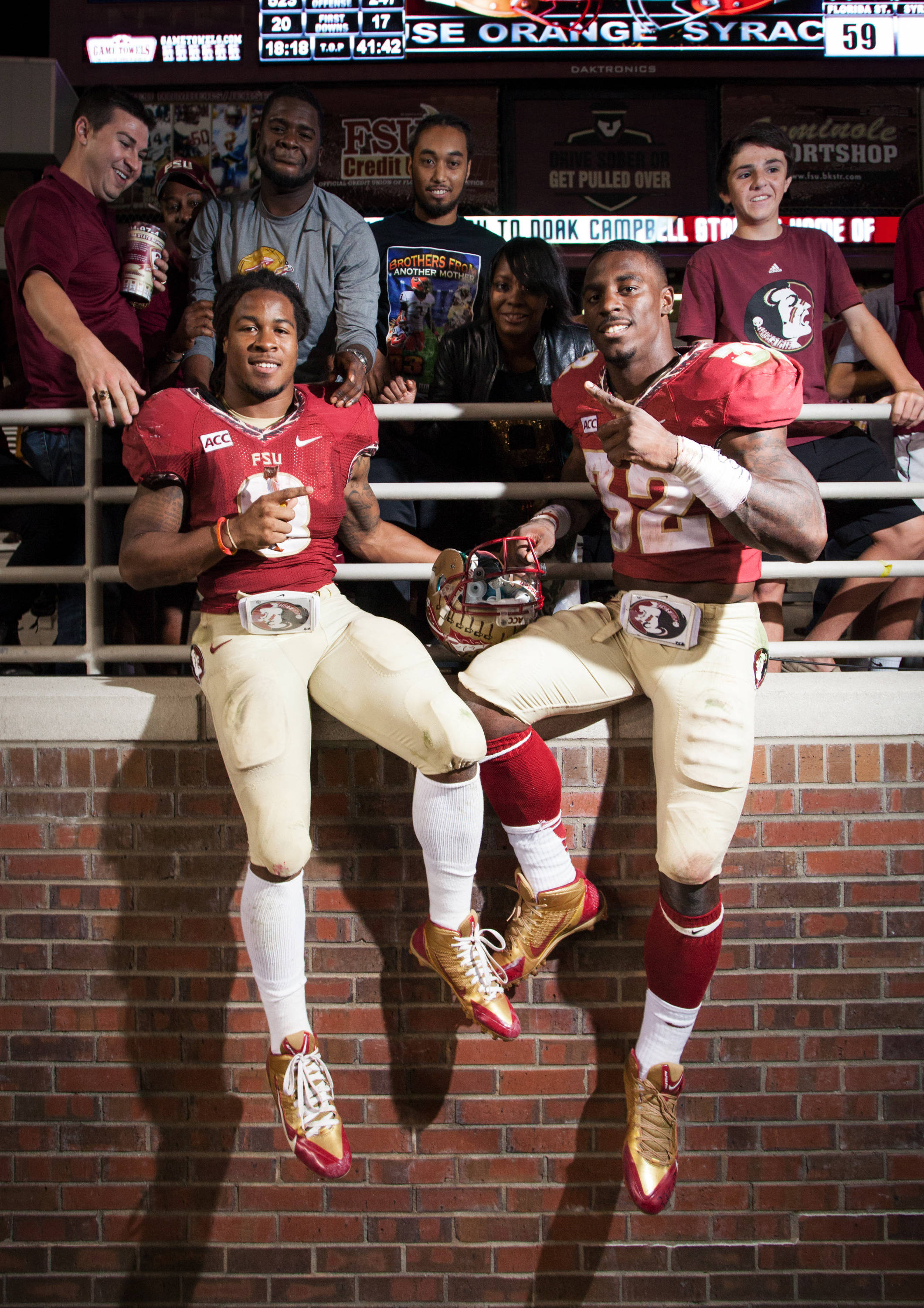 Devonta Freeman (8) and James Wilder, Jr. (32) pose after FSU Football's 59-3 win over Syracuse on Saturday, November 16, 2013 in Tallahassee, Fla. Photo by Mike Schwarz.
