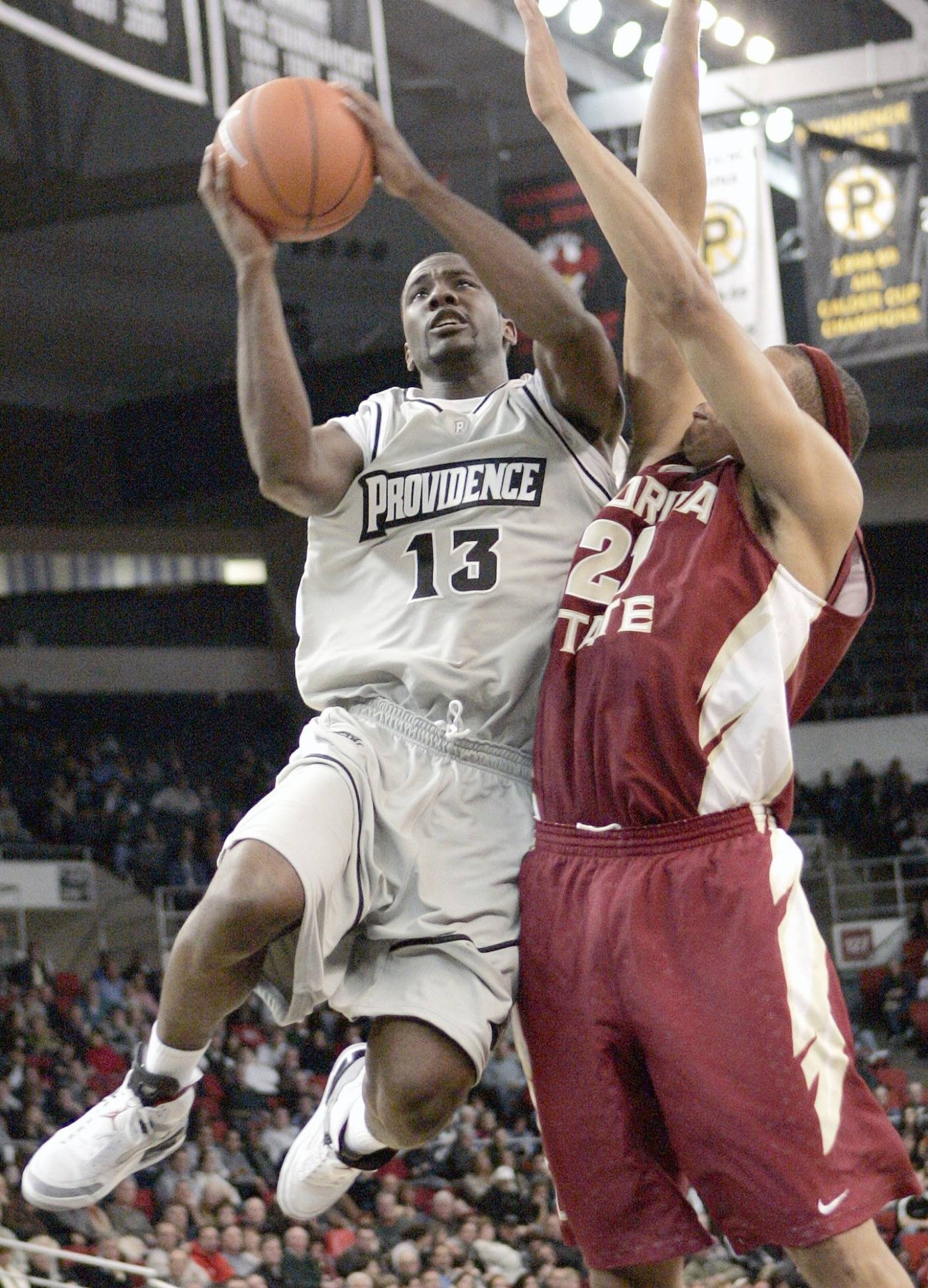 Providence's Weyinmi Efejuku goes up to shoot against Florida State's Julian Vaughn in the first half.