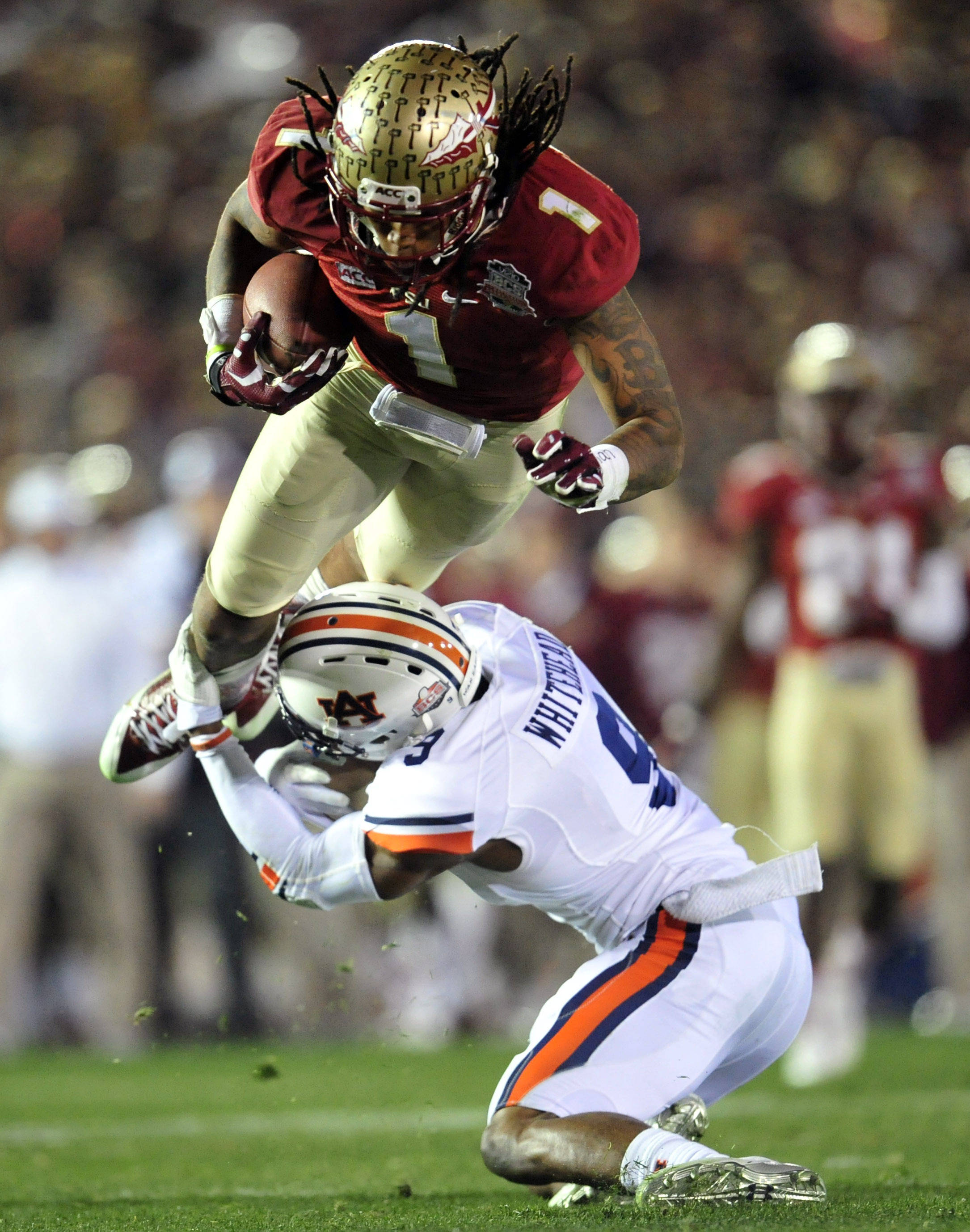 Jan 6, 2014; Pasadena, CA, USA; Florida State Seminoles wide receiver Kelvin Benjamin (1) is upended by Auburn Tigers defensive back Jermaine Whitehead (9) during the second half of the 2014 BCS National Championship game at the Rose Bowl.  Mandatory Credit: Gary A. Vasquez-USA TODAY Sports
