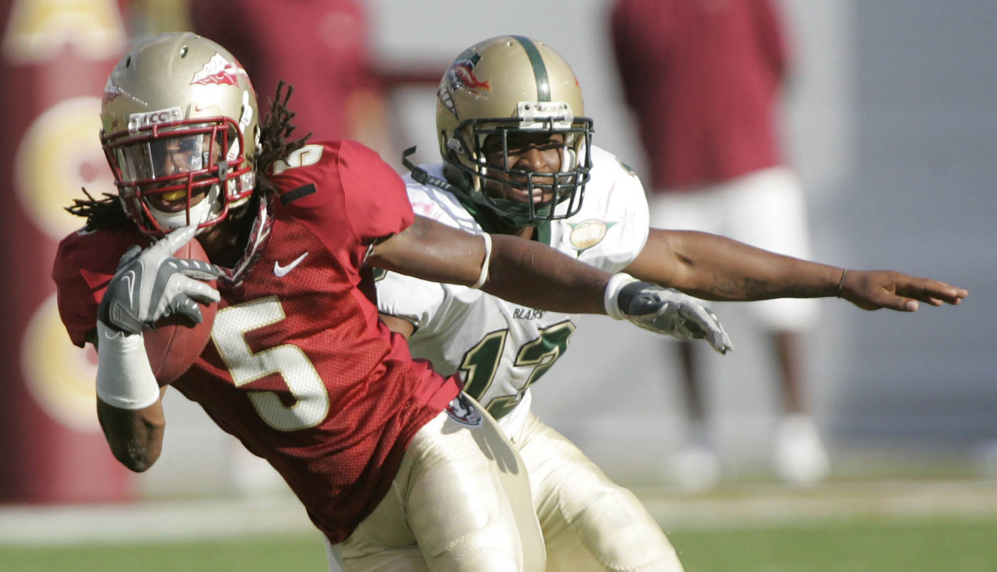 Florida State's Preston Parker, left, returns a first-quarter punt as UAB's Keon Harris can't make the tackle during a football game Saturday, Sept. 8, 2007, in Tallahassee, Fla. (AP Photo/Phil Coale)