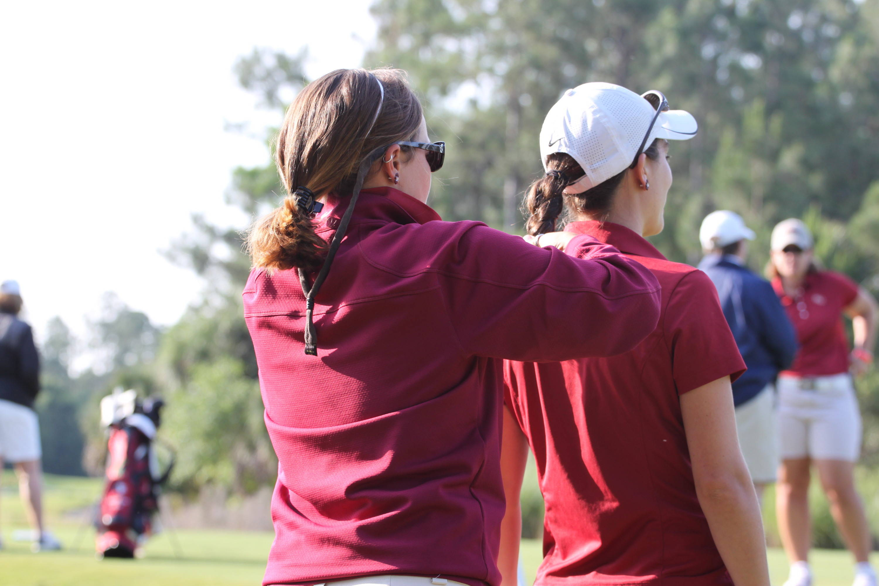2011 NCAA Golf -- Assistant coach Lindsay Koth prepares Macarena Silva for first round play