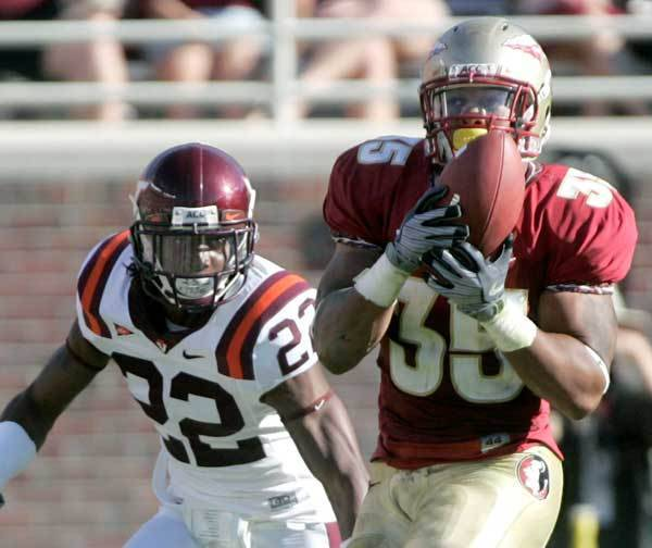 Florida State running back Marcus Sims, right, makes a second-quarter catch.