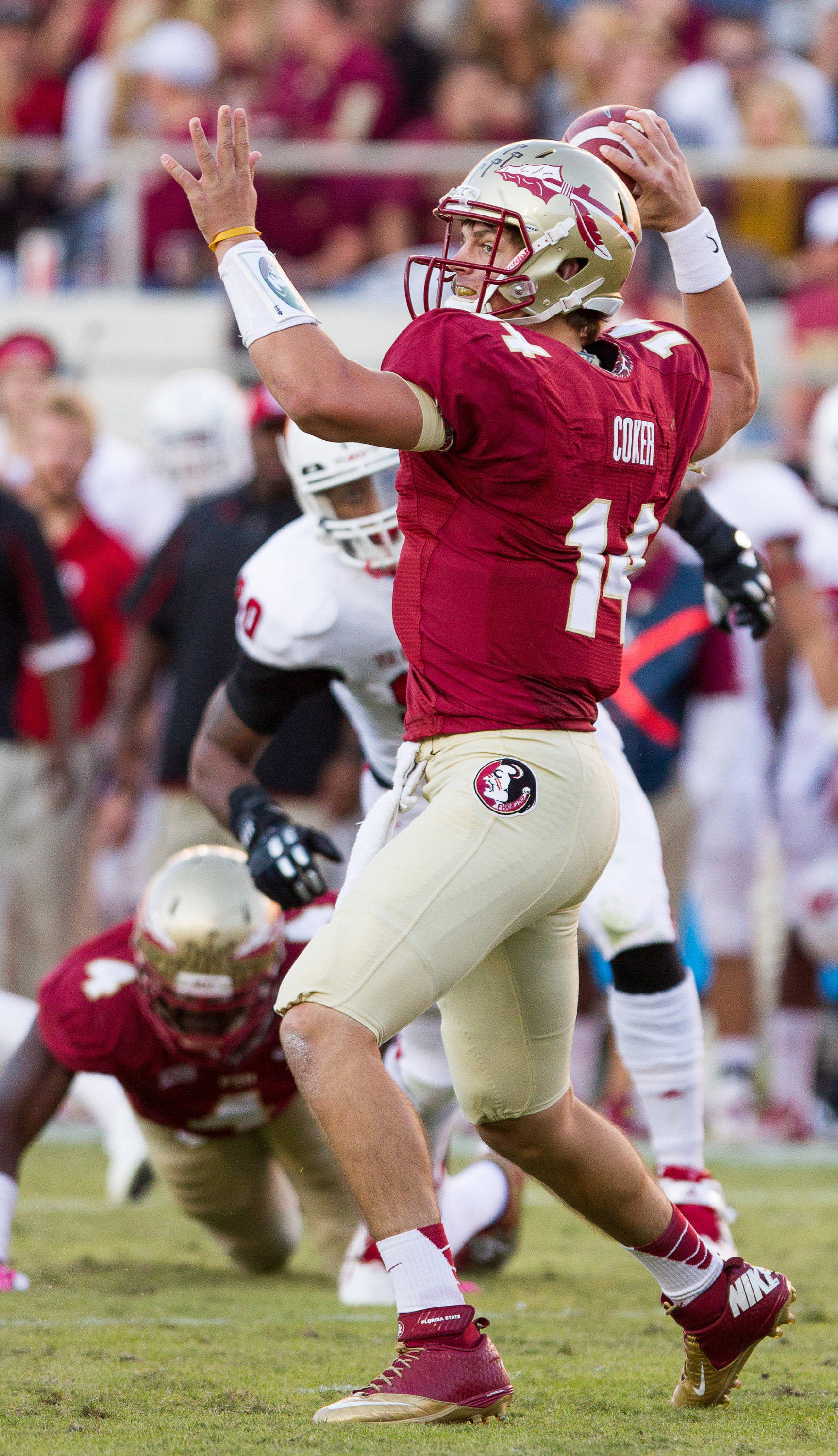 Jacob Coker (14) makes a pass during FSU Football's 49-17 win over NC State on Saturday, October 26, 2013 in Tallahassee, Fla. Photo by Michael Schwarz.