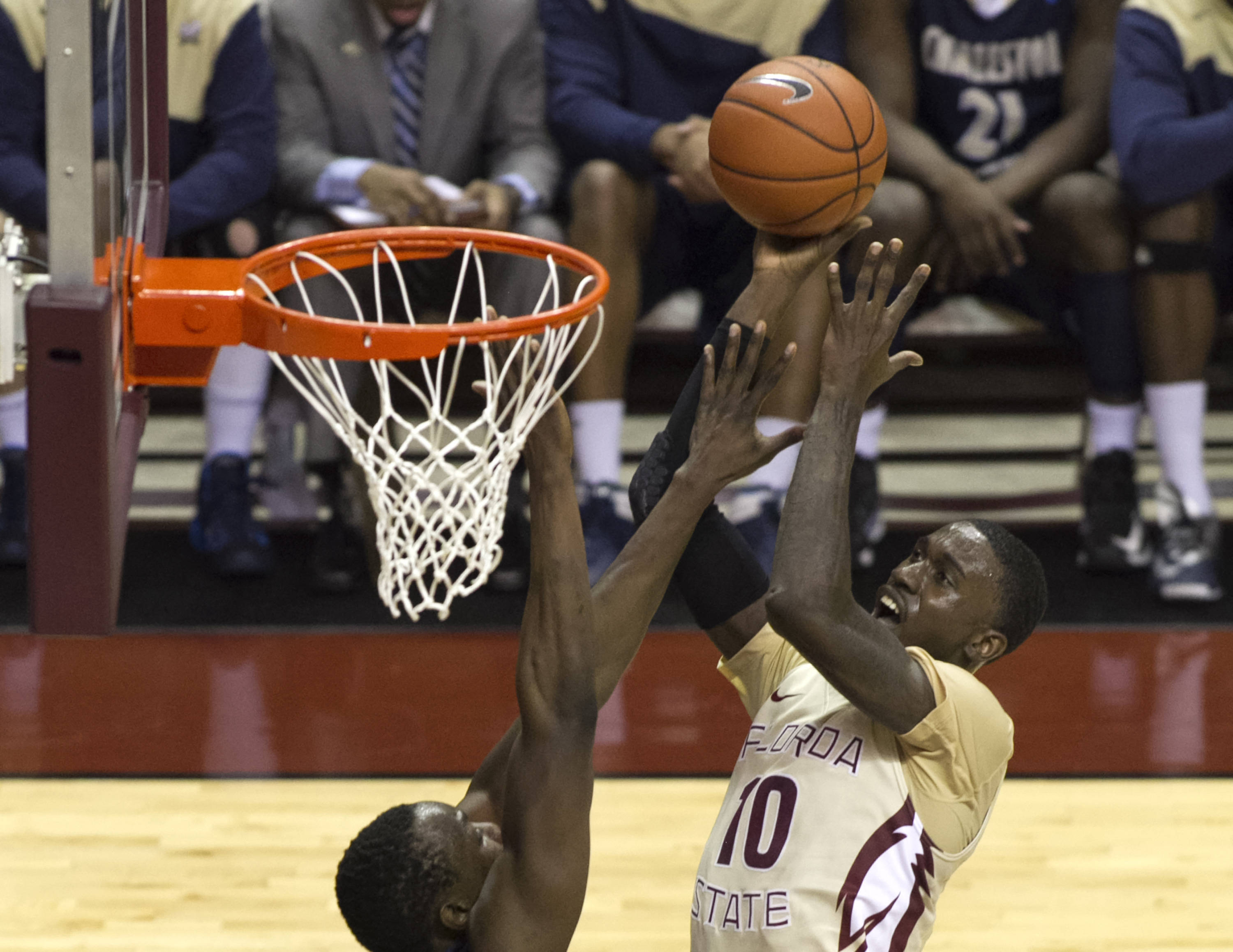 Okaro White (10) going high for two points, FSU vs Charleston Southern, 12-30-13,  (Photo by Steve Musco)