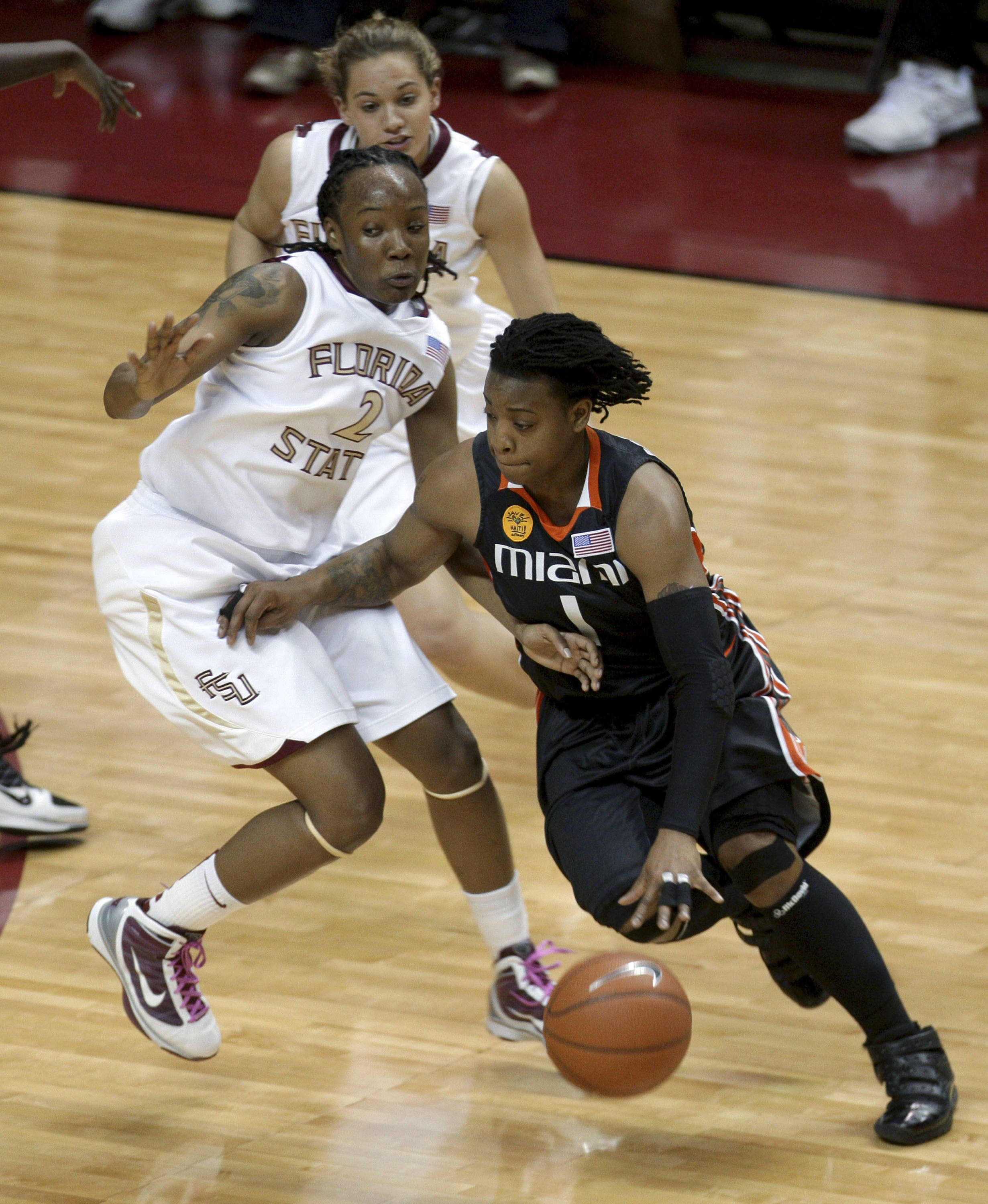 Miami's Riquana Williams, right, drives past Florida State's Alysha Harvin during the first half of an NCAA college basketball game Thursday, Feb. 25, 2010, in Tallahassee, Fla.(AP Photo/Phil Coale)