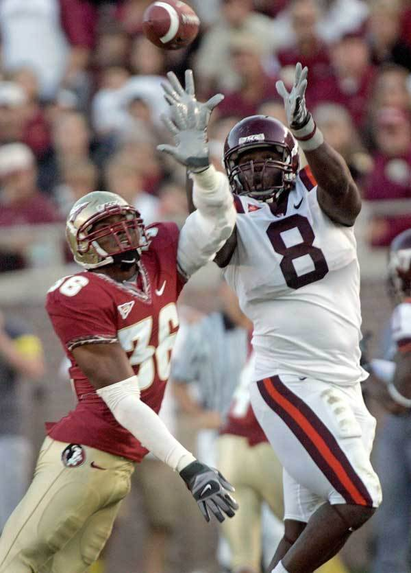 Virginia Tech tight end Greg Boone, right, makes a fourth-quarter catch as Florida State linebacker Dekoda Watson attempts to defend.
